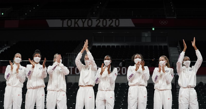 Aug 8, 2021; Tokyo, Japan; USA players on the podium after defeating Brazil in the women's volleyball gold medal match during the Tokyo 2020 Olympic Summer Games at Ariake Arena. Mandatory Credit: Grace Hollars-USA TODAY Sports