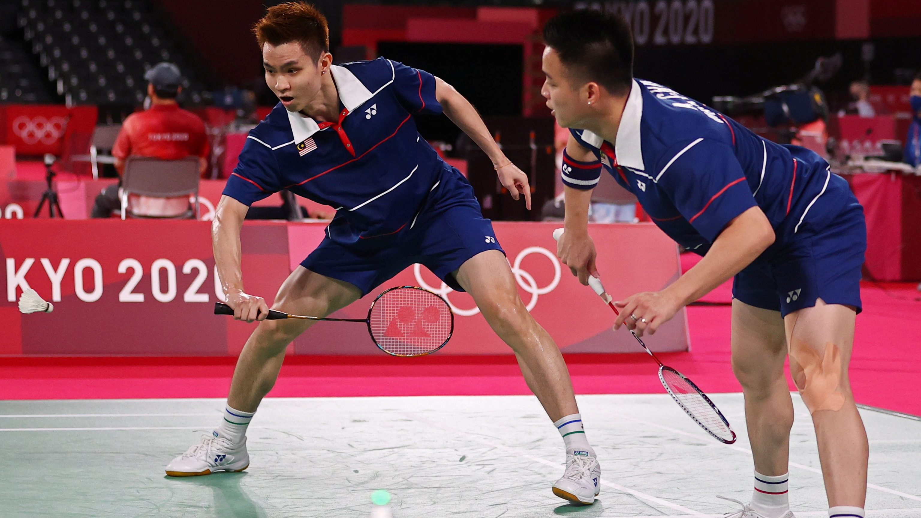 Tokyo 2020 Olympics - Badminton - Men's Doubles - Quarterfinal - MFS - Musashino Forest Sport Plaza, Tokyo, Japan – July 29, 2021. Soh Wooi Yik of Malaysia and Aaron Chia of Malaysia in action during the match against Marcus Fernaldi Gideon of Indonesia and Kevin Sanjaya Sukamuljo of Indonesia. REUTERS/Hamad I Mohammed