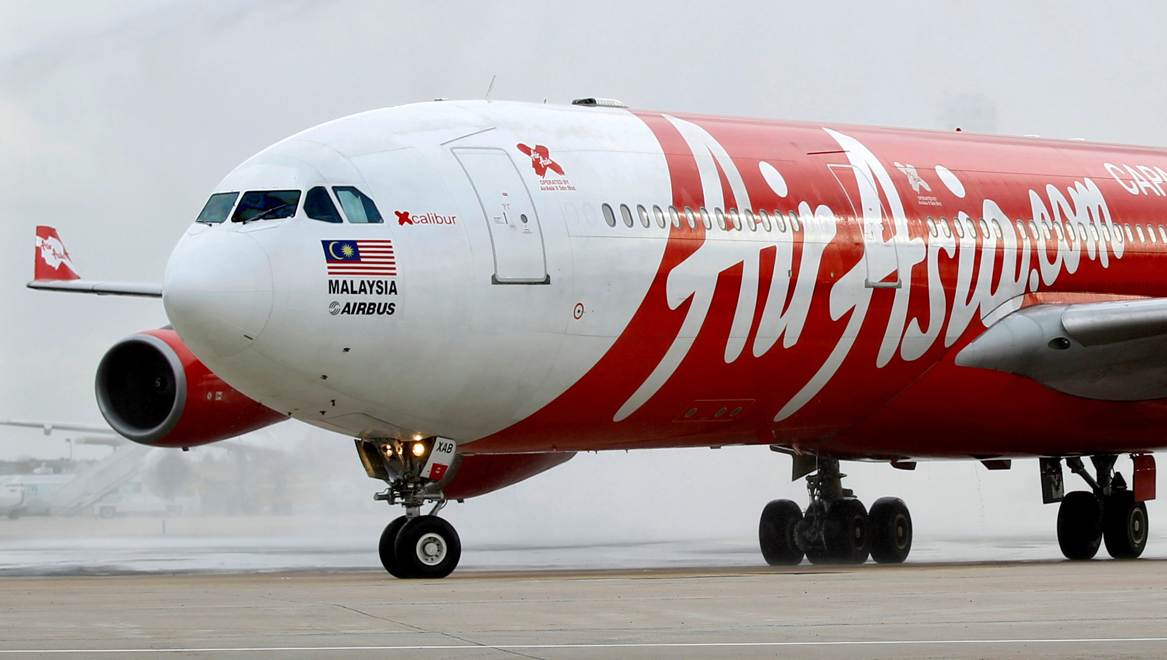 An AirAsia X  Airbus A340 passenger jet arrives on its inaugural flight from Kuala Lumpur to Paris Orly Airport  in this February 14, 2011. REUTERS/Charles Platiau