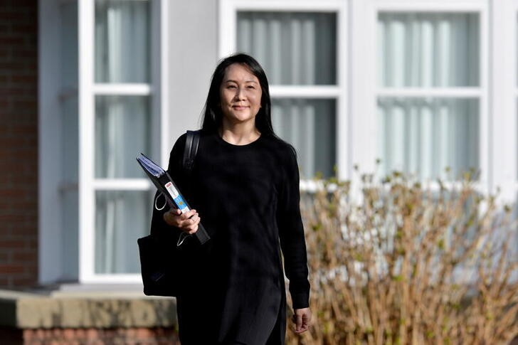 Huawei Technologies Chief Financial Officer Meng Wanzhou leaves her home to attend a court hearing in Vancouver, British Columbia, Canada March 22, 2021. REUTERS/Jennifer Gauthier