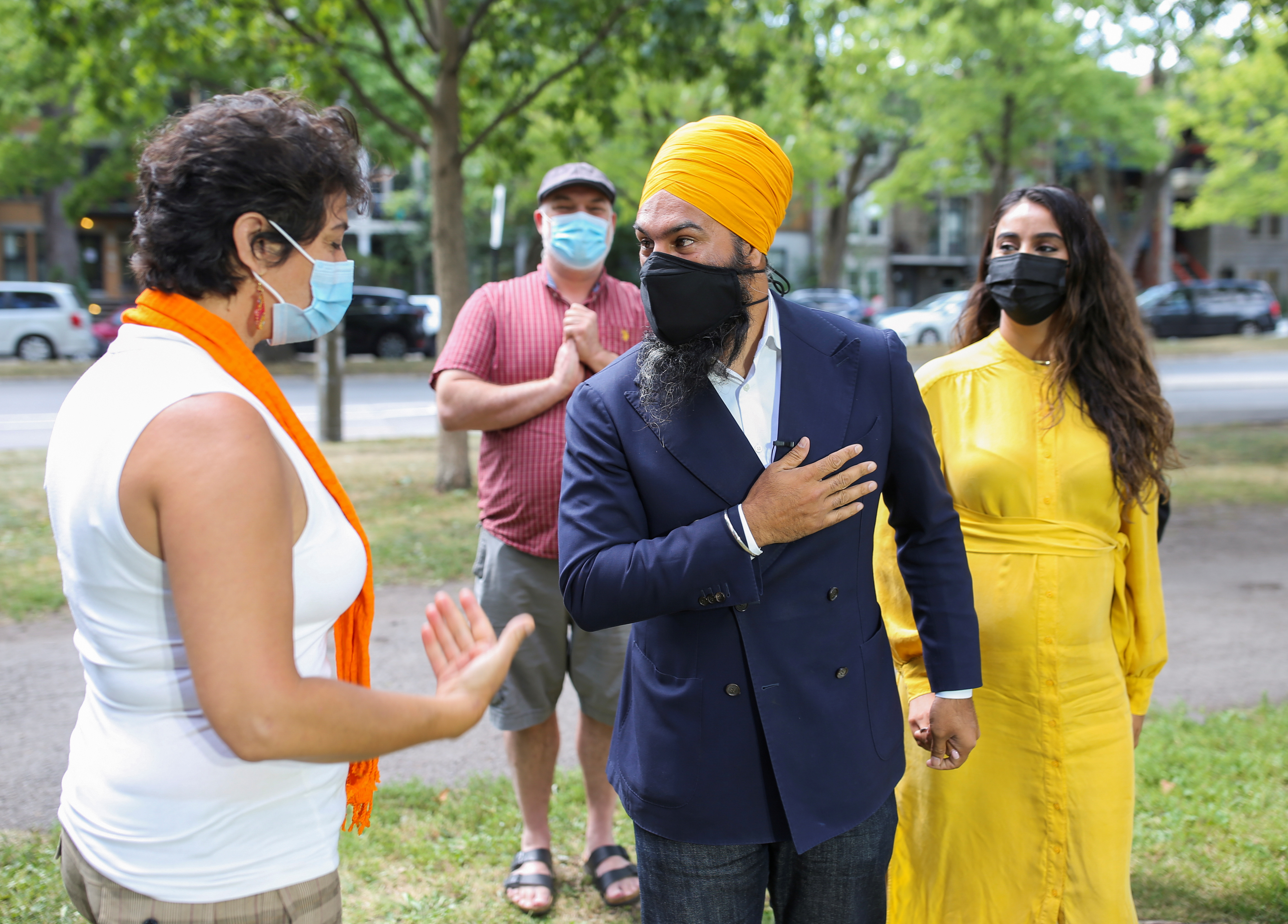 Canada's New Democratic Party (NDP) leader Jagmeet Singh with his wife Gurkiran Kaur Sidhu greet candidates and supporters prior to speaking with the press after Prime Minister Justin Trudeau called an early election, in Montreal, Quebec, Canada August 15, 2021.  REUTERS/Christinne Muschi