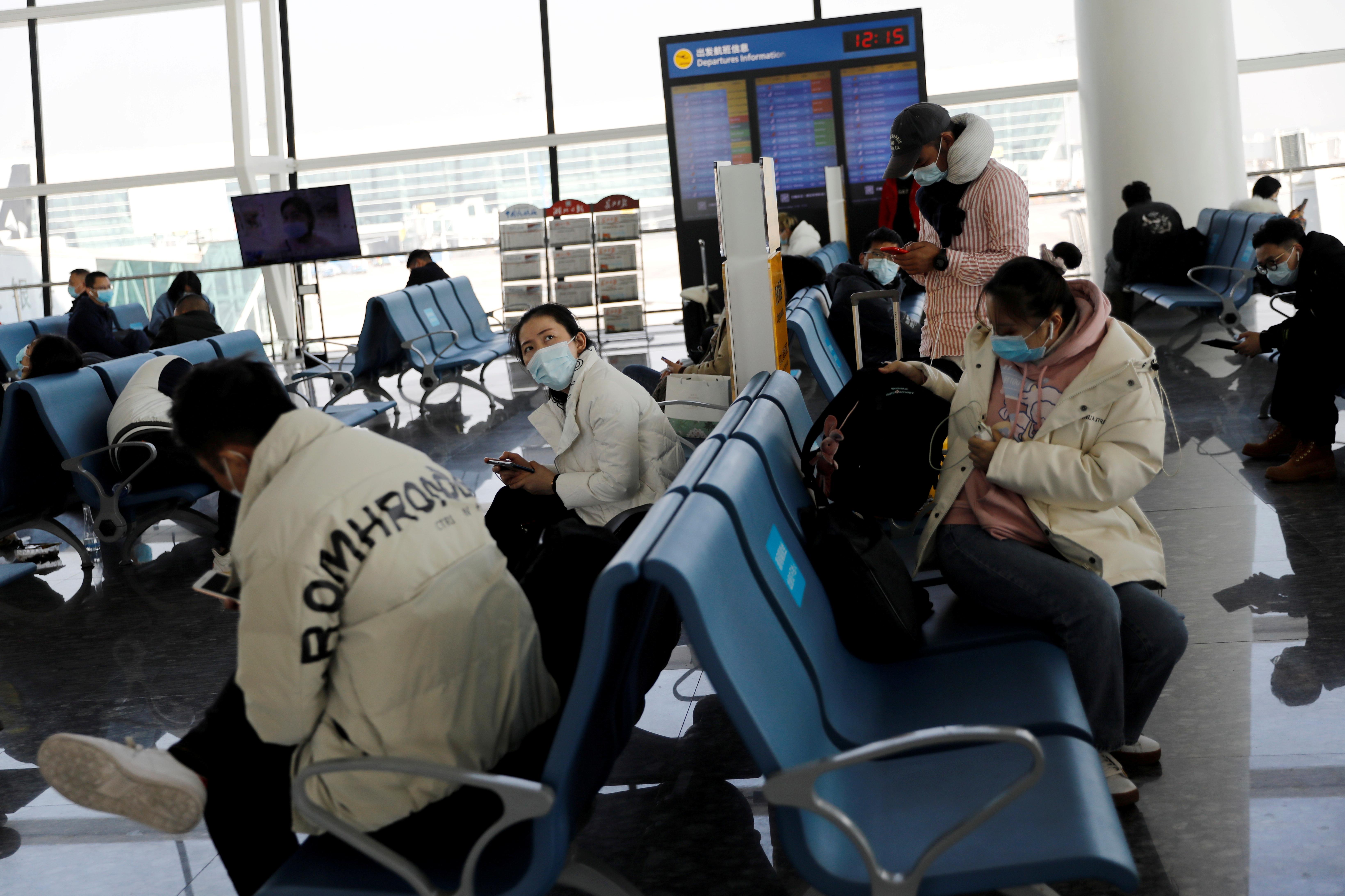 Travellers wait at Wuhan Tianhe International Airport following the coronavirus disease (COVID-19) outbreak in Wuhan, Hubei province, China January 2, 2021. REUTERS/Tingshu Wang/File Photo