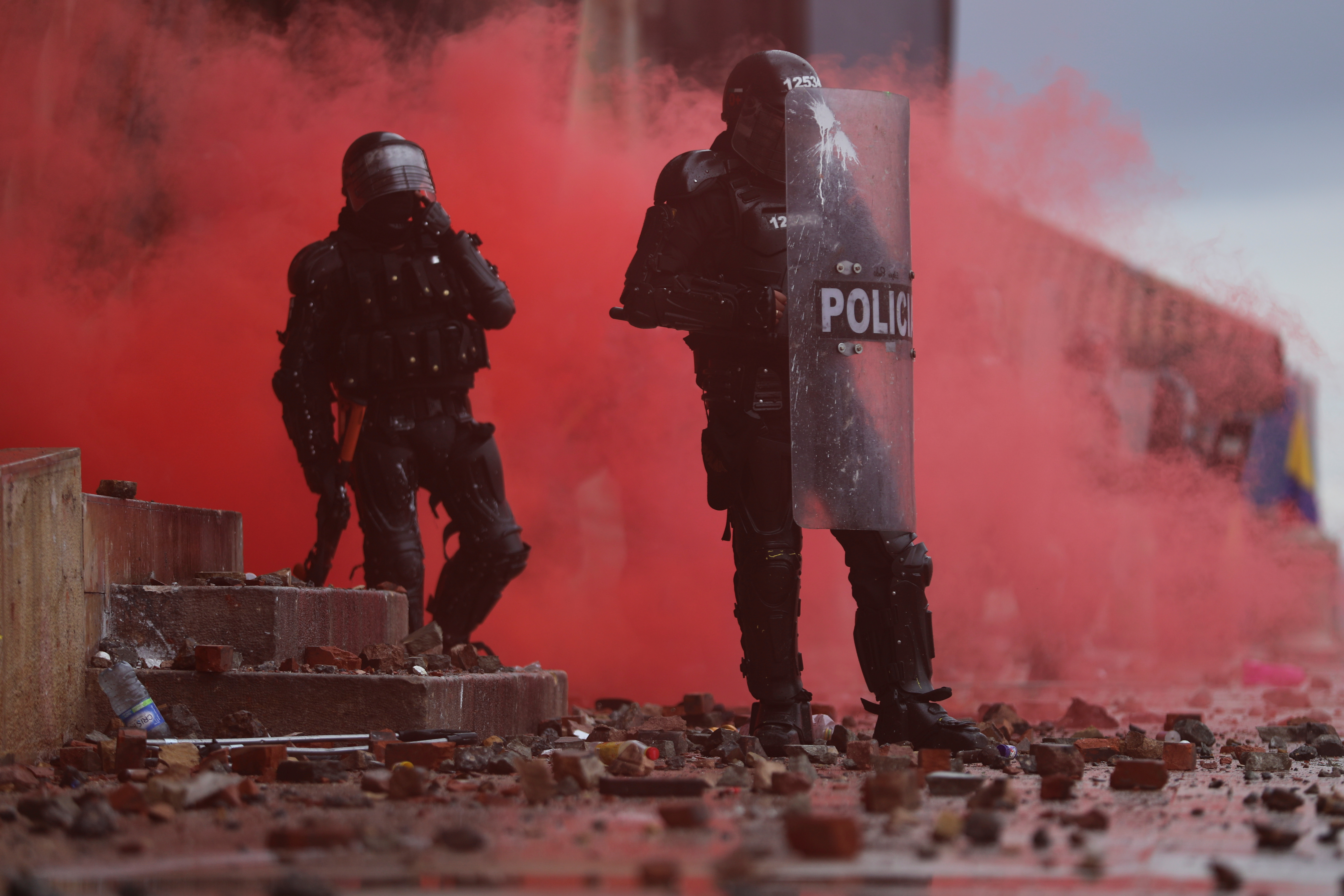 Police officers are seen during a protest against poverty and police violence in Bogota, Colombia, May 5, 2021. REUTERS/Luisa Gonzalez
