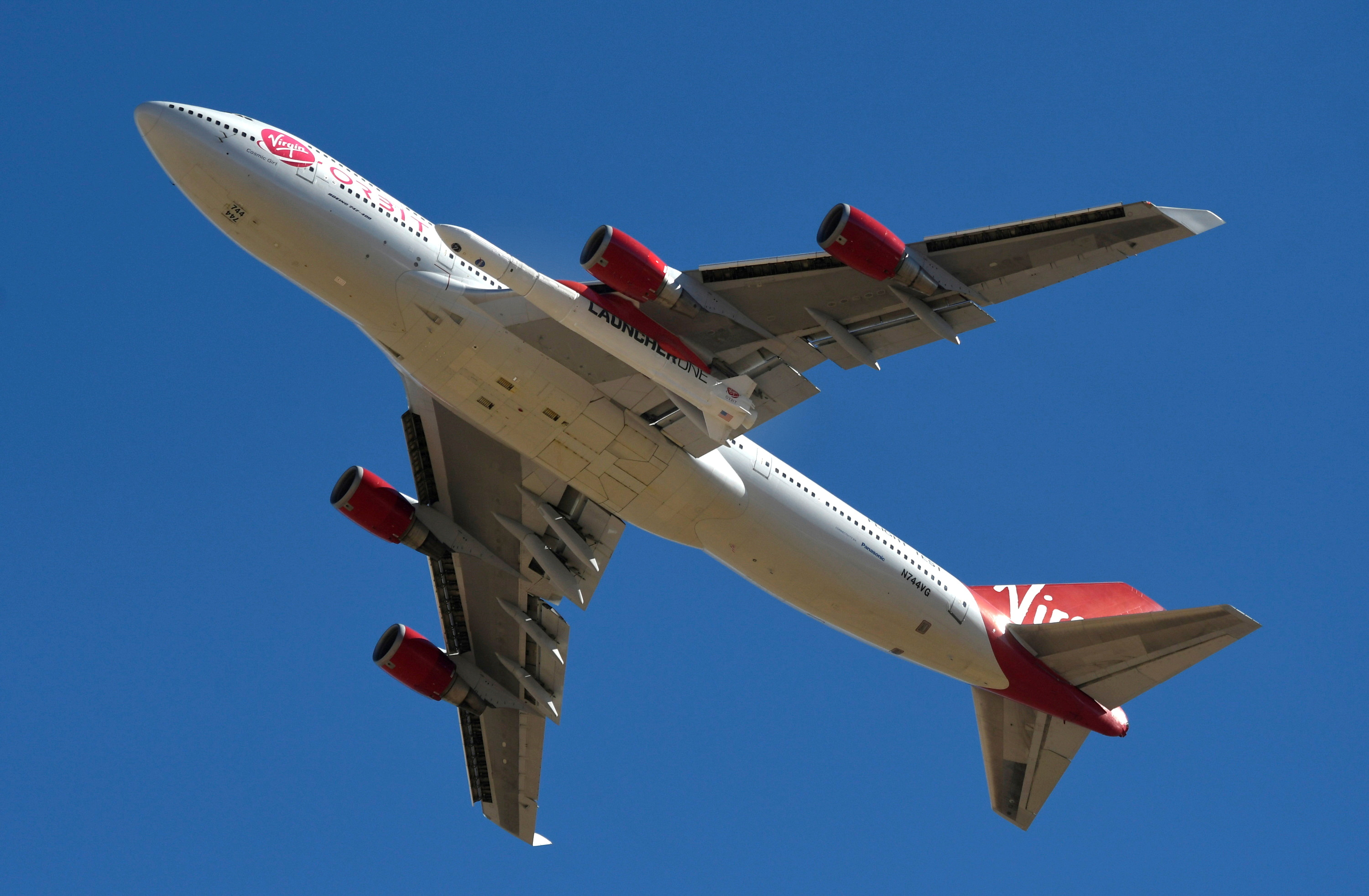 A view of Richard Branson's Virgin Orbit, with a rocket underneath the wing of a modified Boeing 747 jetliner, during test launch of its high-altitude launch system for satellites from Mojave, California, U.S. January 17, 2021.  REUTERS/Gene Blevins/File Photo
