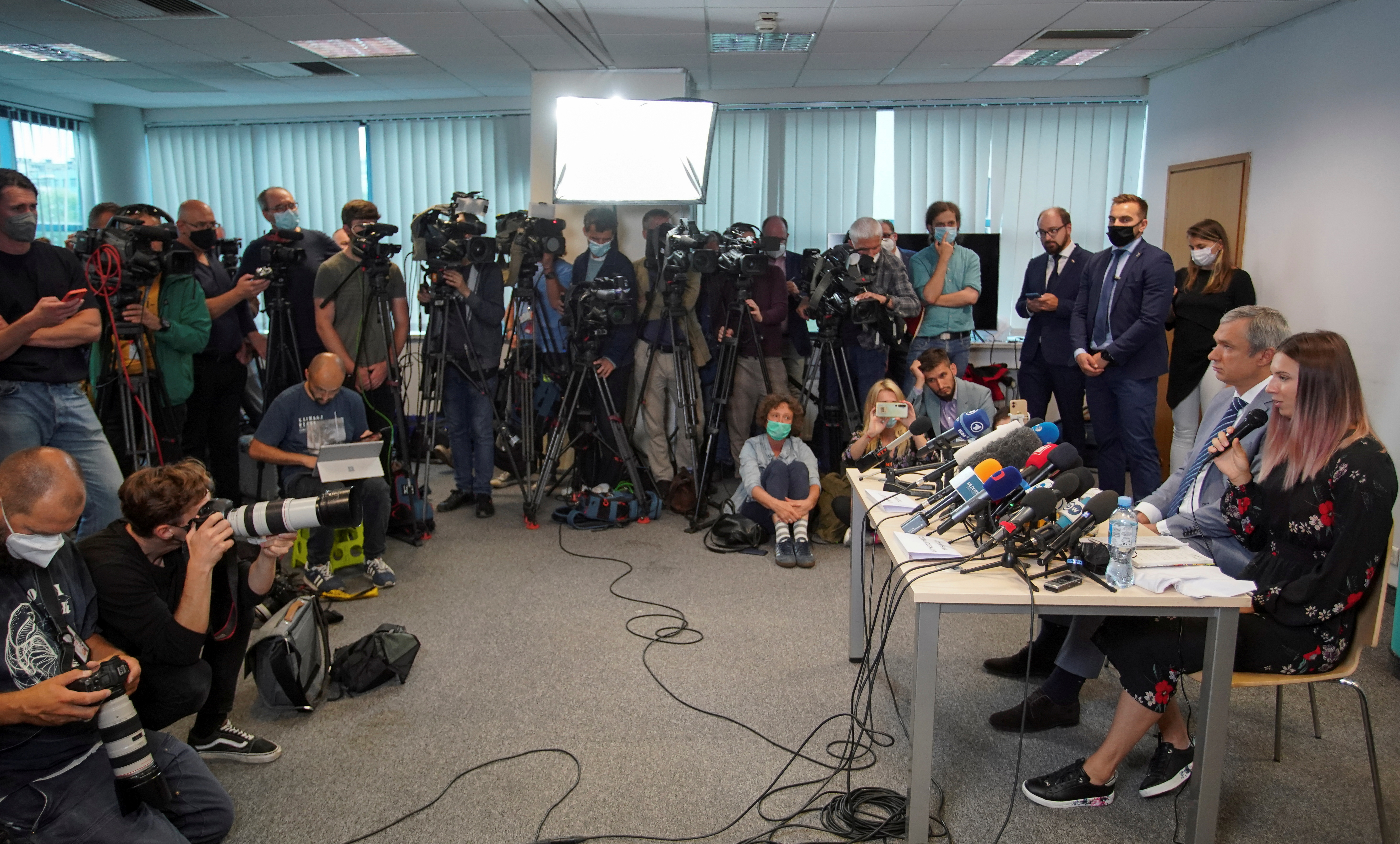 Belarusian sprinter Krystsina Tsimanouskaya, who left the Olympic Games in Tokyo and seeks asylum in Poland, and Belarusian opposition politician Pavel Latushka  attend a news conference in Warsaw, Poland August 5, 2021. REUTERS/Darek Golik