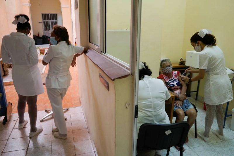 A woman receives a dose of the Abdala vaccine at a vaccination center amid concerns about the spread of the coronavirus disease (COVID-19), in Havana, Cuba, August 2, 2021. Picture taken on August 2, 2021. REUTERS/Alexandre Meneghini