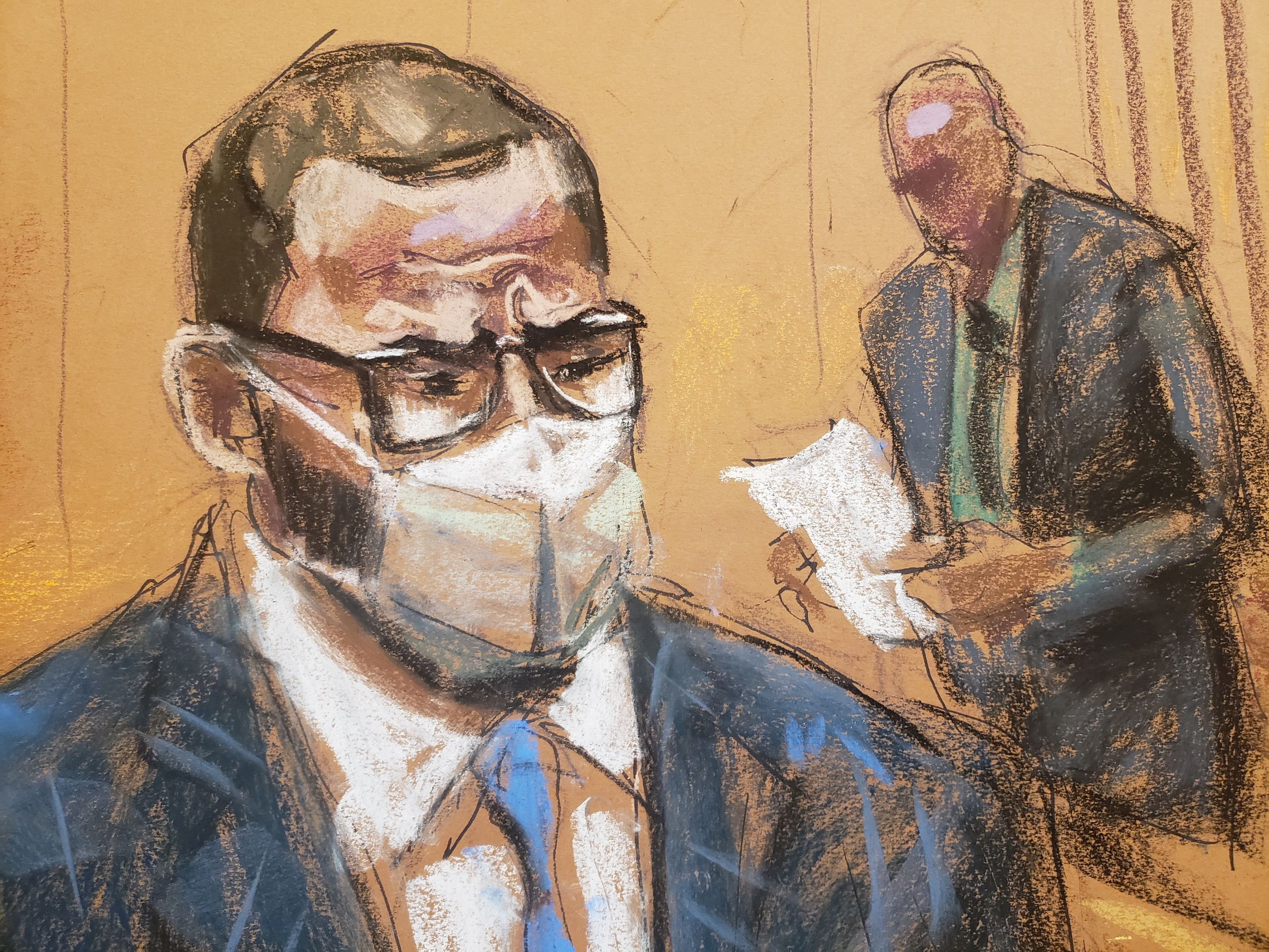 R. Kelly sits as the jury foreman reads the guilty verdict in Kelly's sex abuse trial at Brooklyn's Federal District Court in a courtroom sketch in New York, U.S., September 27, 2021. REUTERS/Jane Rosenberg