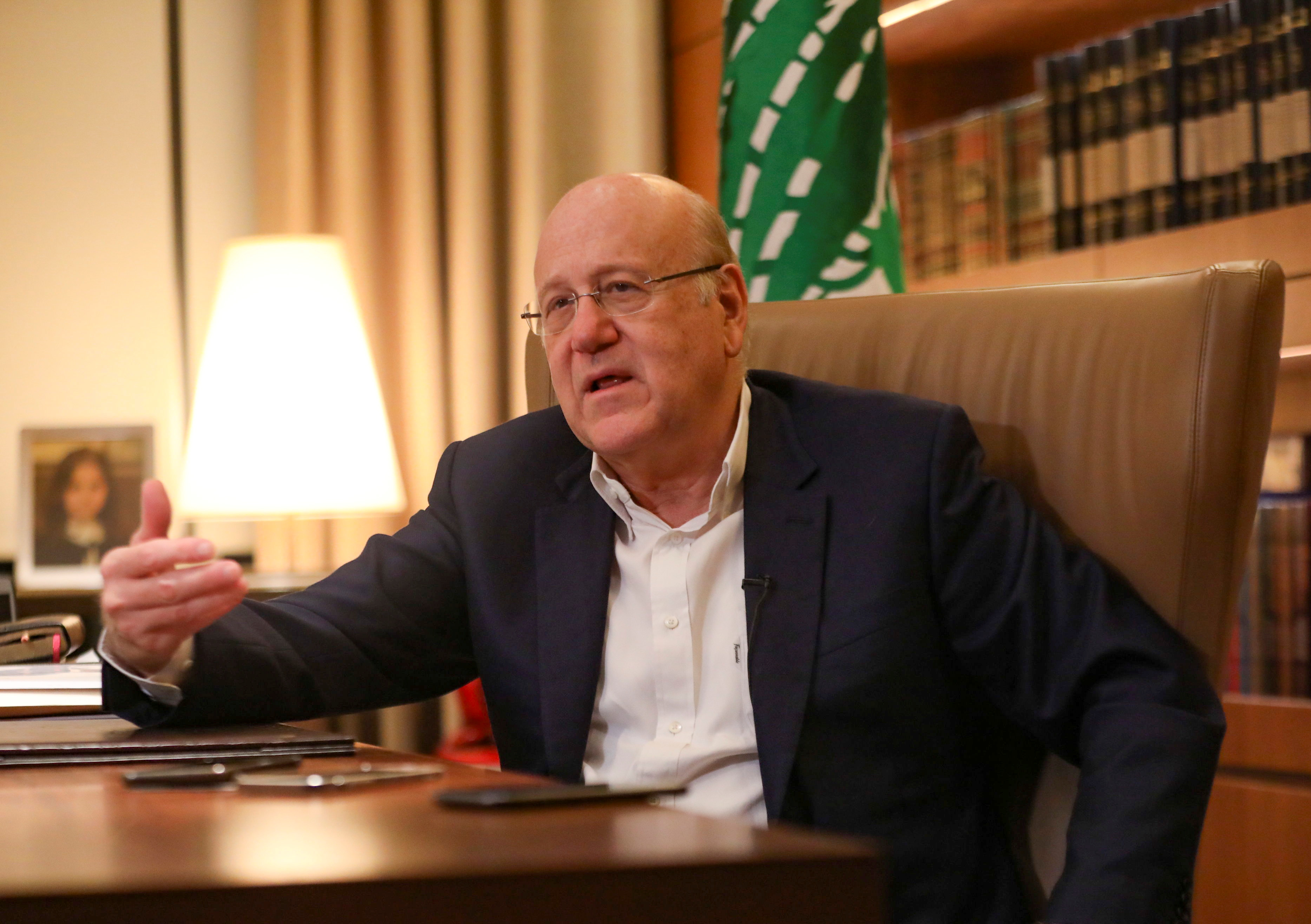 Lebanese Prime Minister Najib Mikati speaks during an interview with Reuters at the government palace in Beirut, Lebanon October 14, 2021. REUTERS/Mohamed Azakir