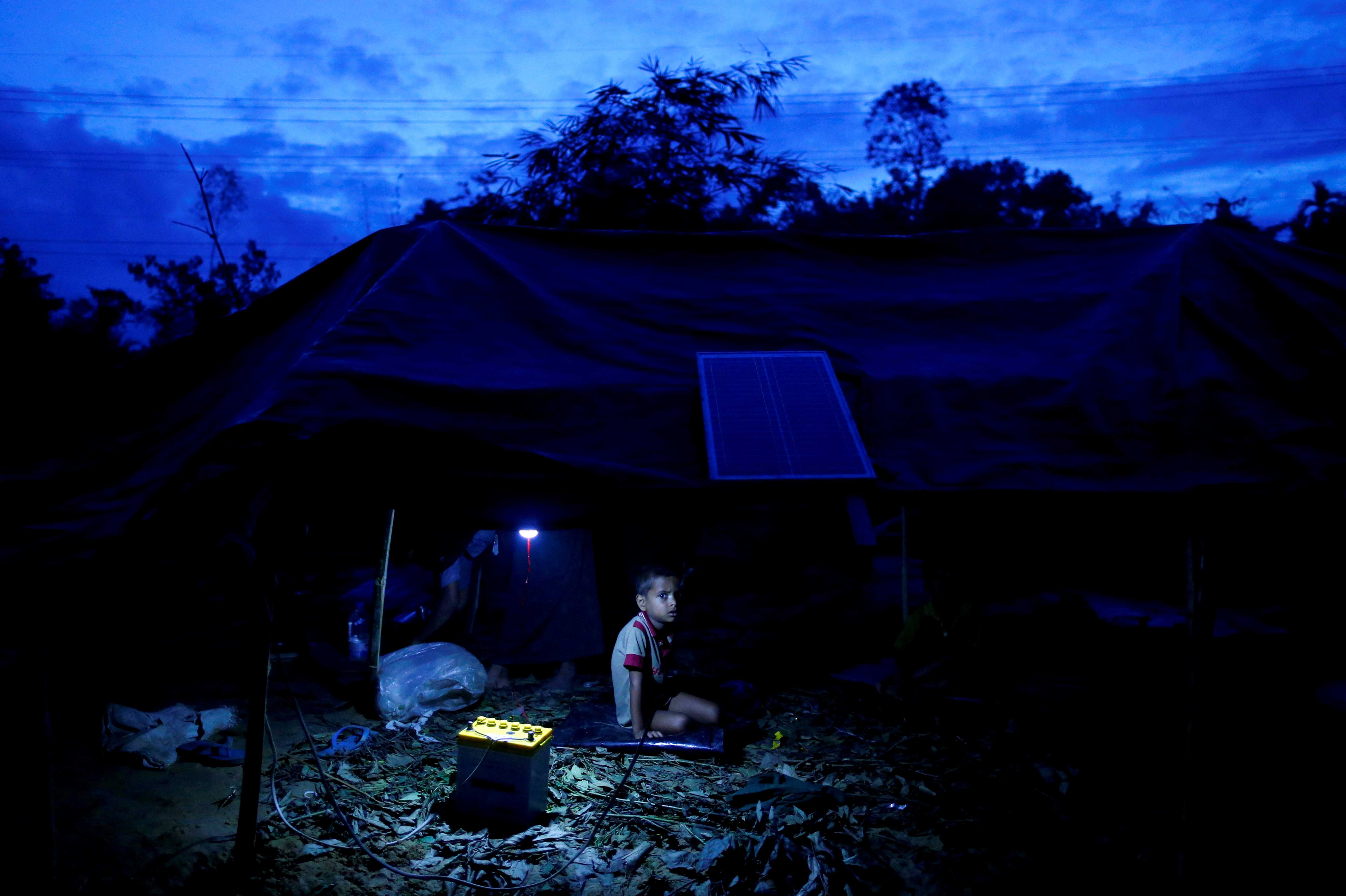 A Rohingya refugee boy sits inside his temporary shelter near Balukhali in Cox's Bazar, Bangladesh, September 12, 2017. REUTERS/Danish Siddiqui/File Photo/File Photo