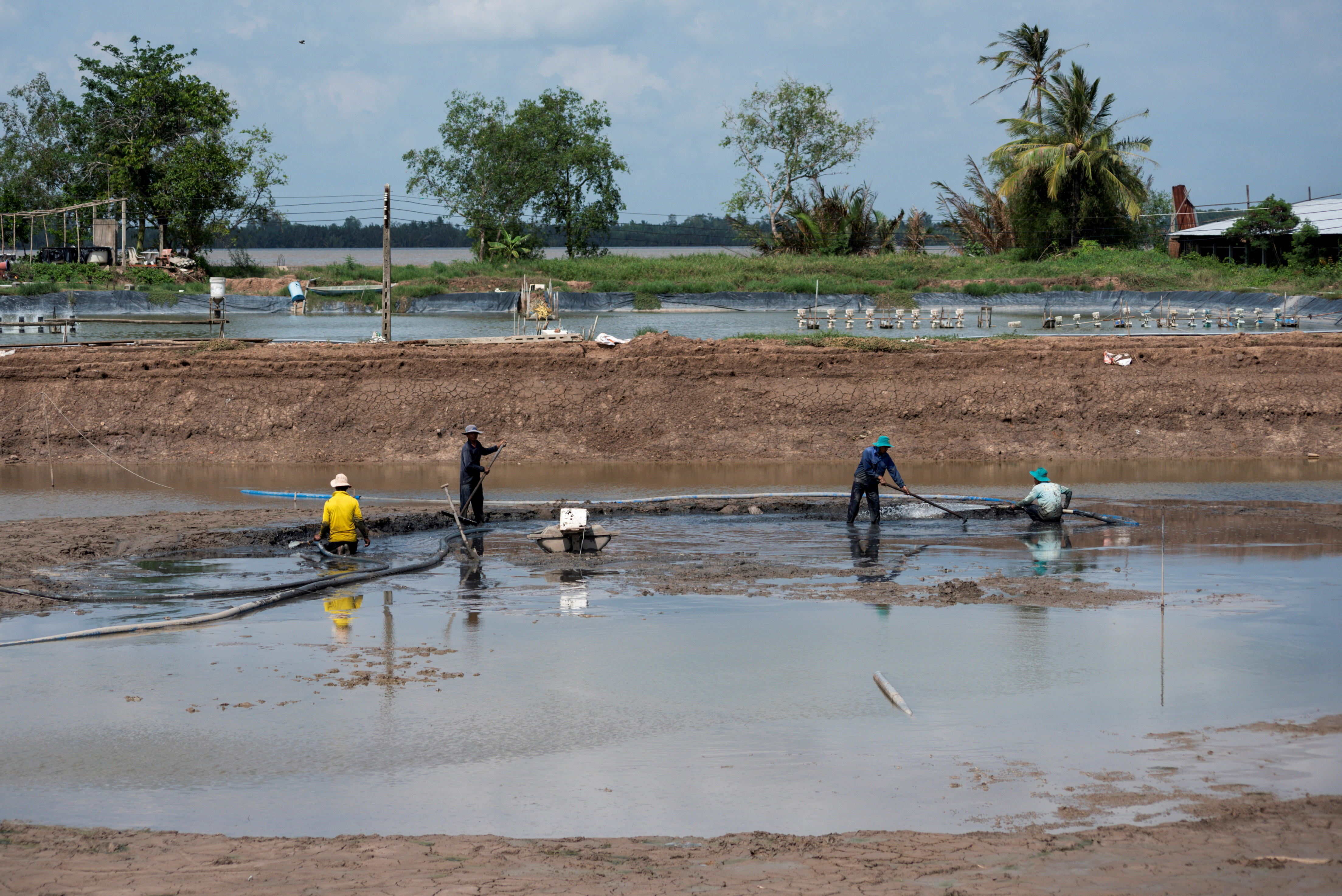 Farmers prepare former rice fields into pools to farm shrimps in Soc Trang province, Vietnam, April 28, 2021. Picture taken April 28, 2021. REUTERS/Thanh Hue/File Photo