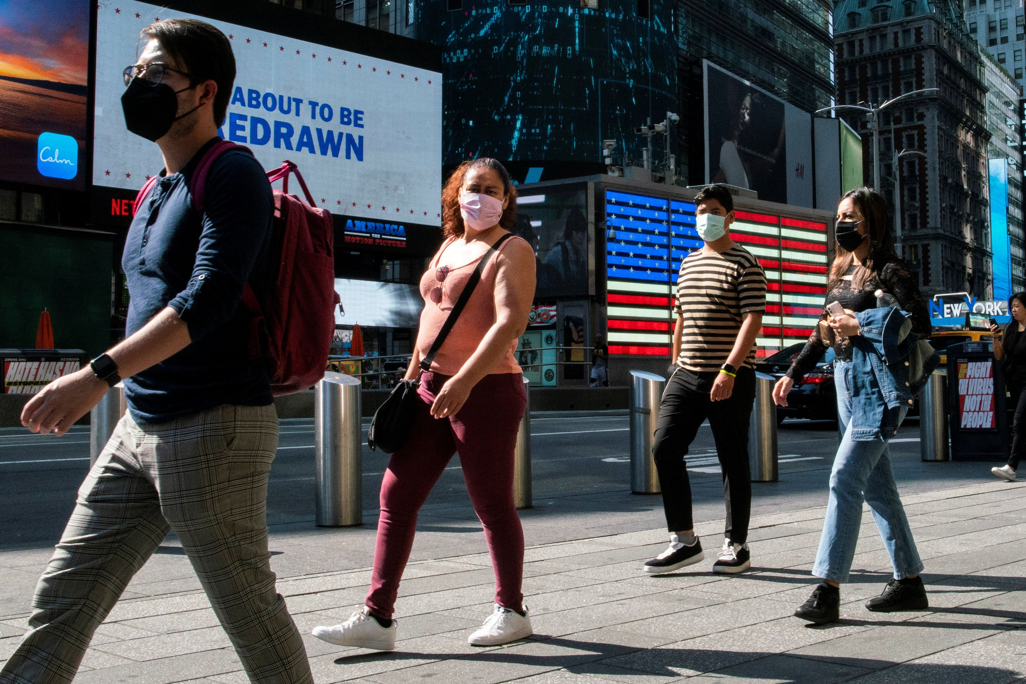 People wear masks around Times Square, as cases of the infectious coronavirus Delta variant continue to rise in New York City, New York, U.S., July 23, 2021. REUTERS/Eduardo Munoz