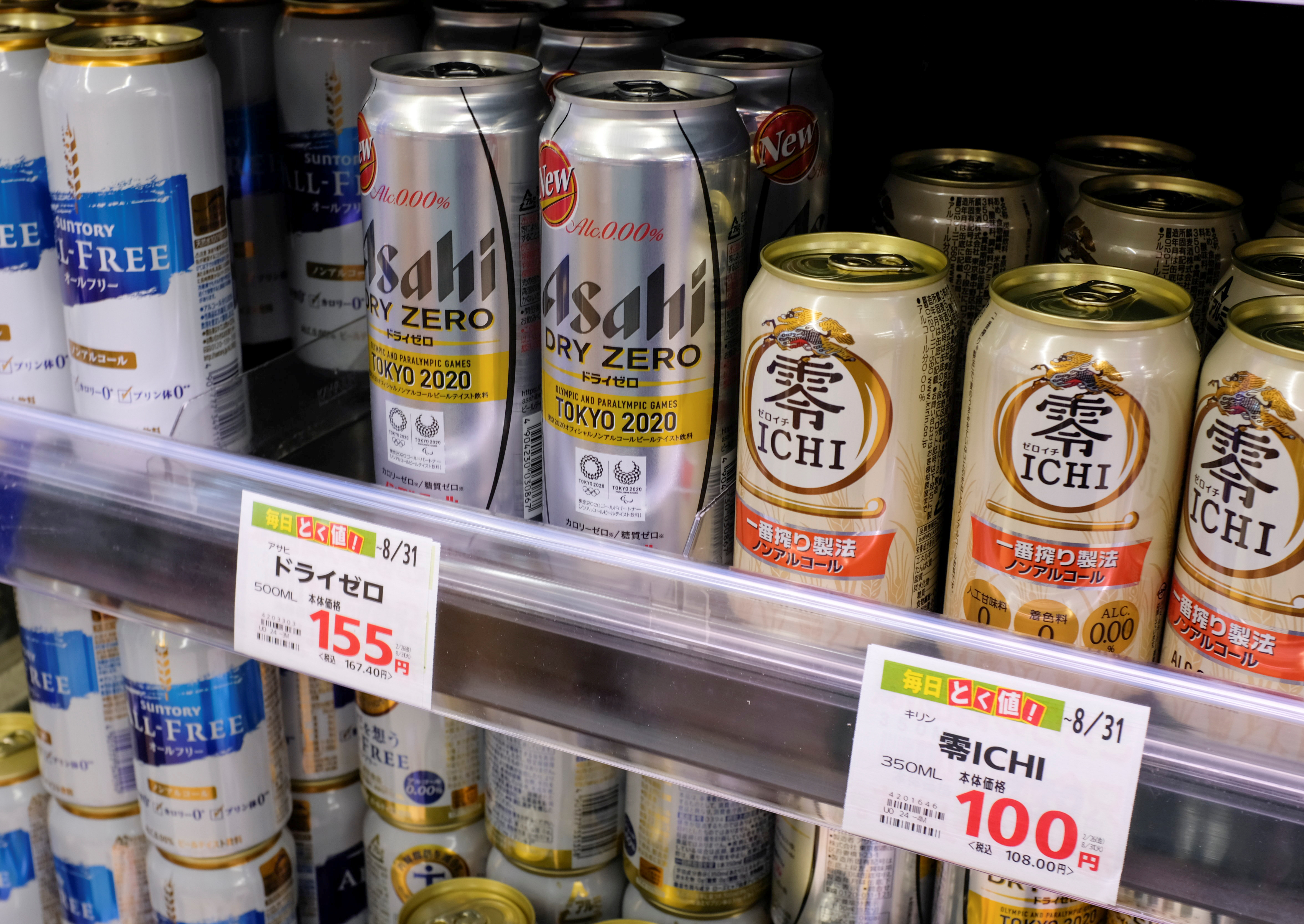 Various cans of alcohol-free beers, including those from Asahi, Kirin and Suntory, are displayed on a supermarket shelf in Tokyo, Japan March 9, 2021. Picture taken March 9, 2021.  REUTERS/Ritsuko Ando