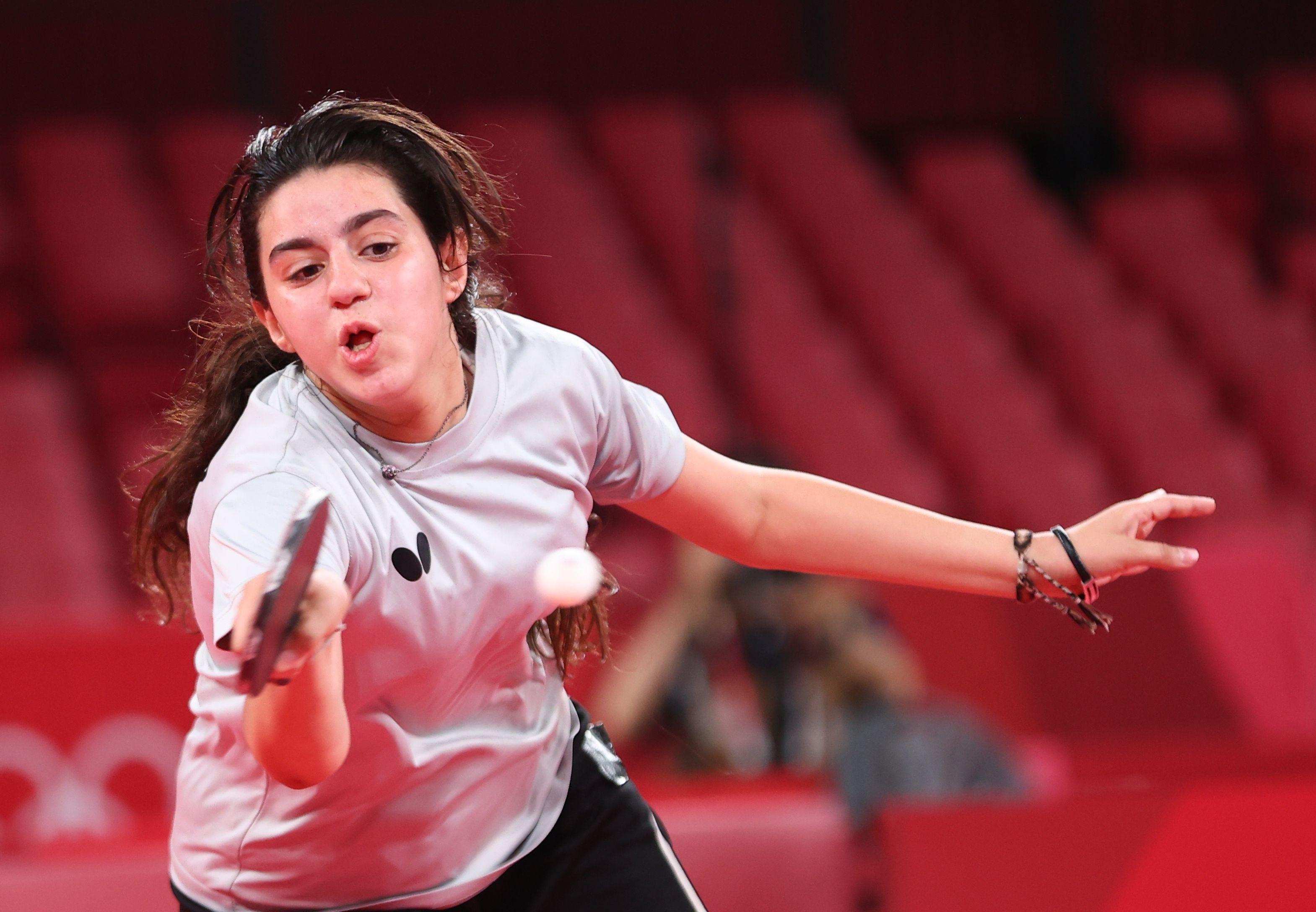 Tokyo 2020 Olympics - Table Tennis - Women's Singles - Preliminary Round - Tokyo Metropolitan Gymnasium - Tokyo, Japan - July 24, 2021.  Hend Zaza of Syria in action against Jia Liu of Austria REUTERS/Luisa Gonzalez