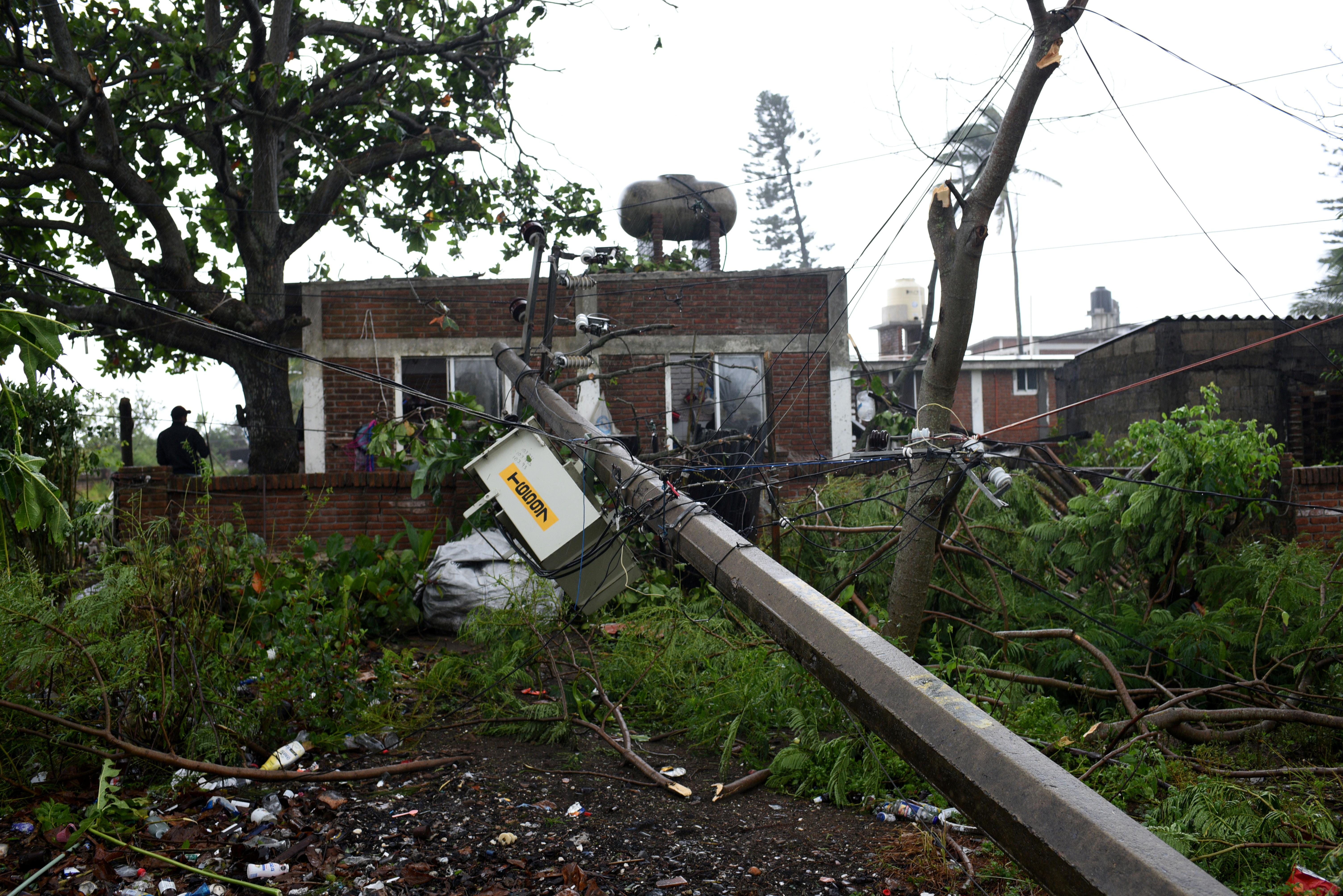 A fallen power pole lies next to houses after Hurricane Grace slammed into the coast with torrential rains, in Costa Esmeralda, near Tecolutla, Mexico August 21, 2021.   REUTERS/Yahir Ceballos