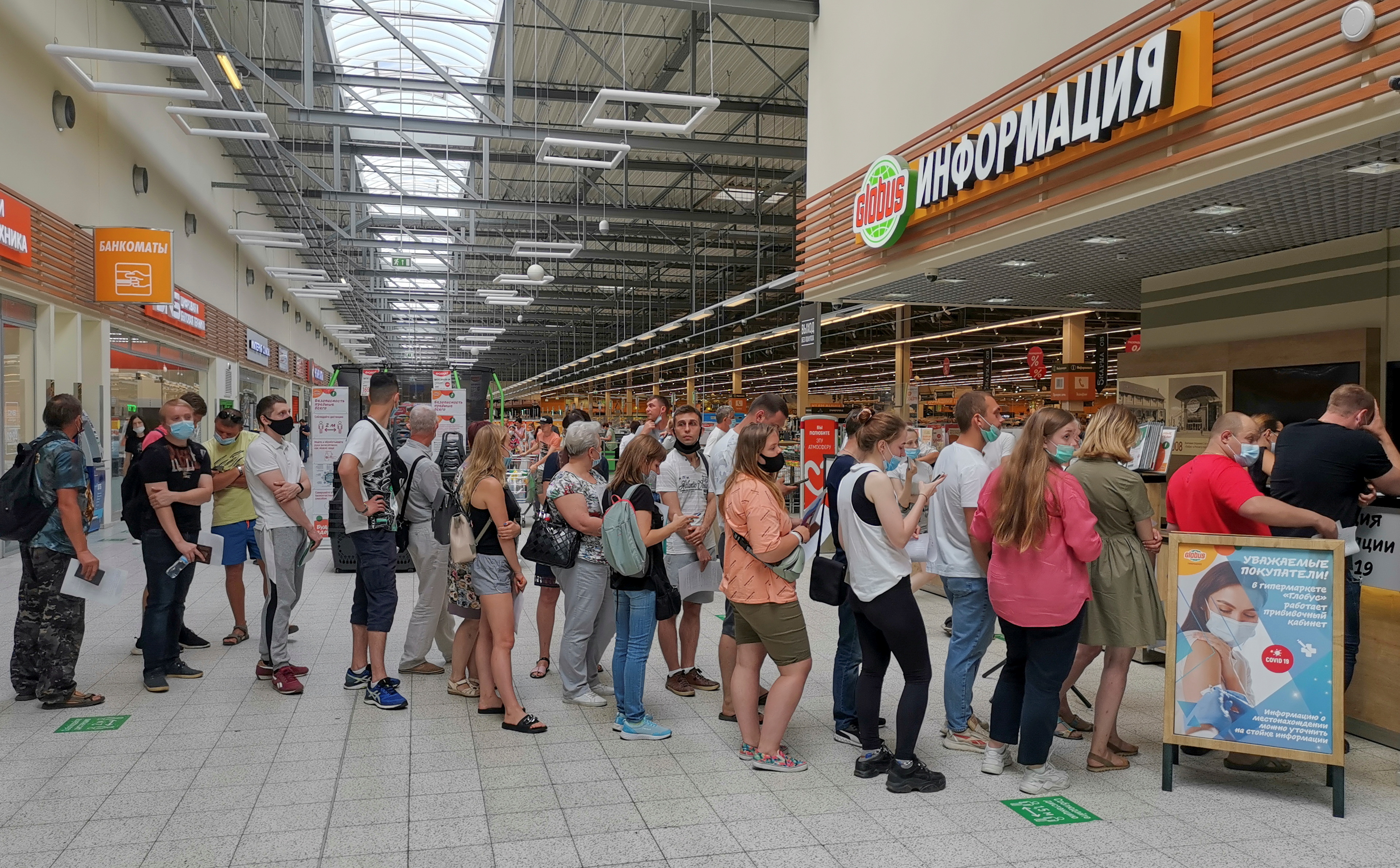 People line up to receive vaccine against the coronavirus disease (COVID-19) at a vaccination centre in the Globus shopping mall in Vladimir, Russia July 15, 2021. REUTERS/Polina Nikolskaya