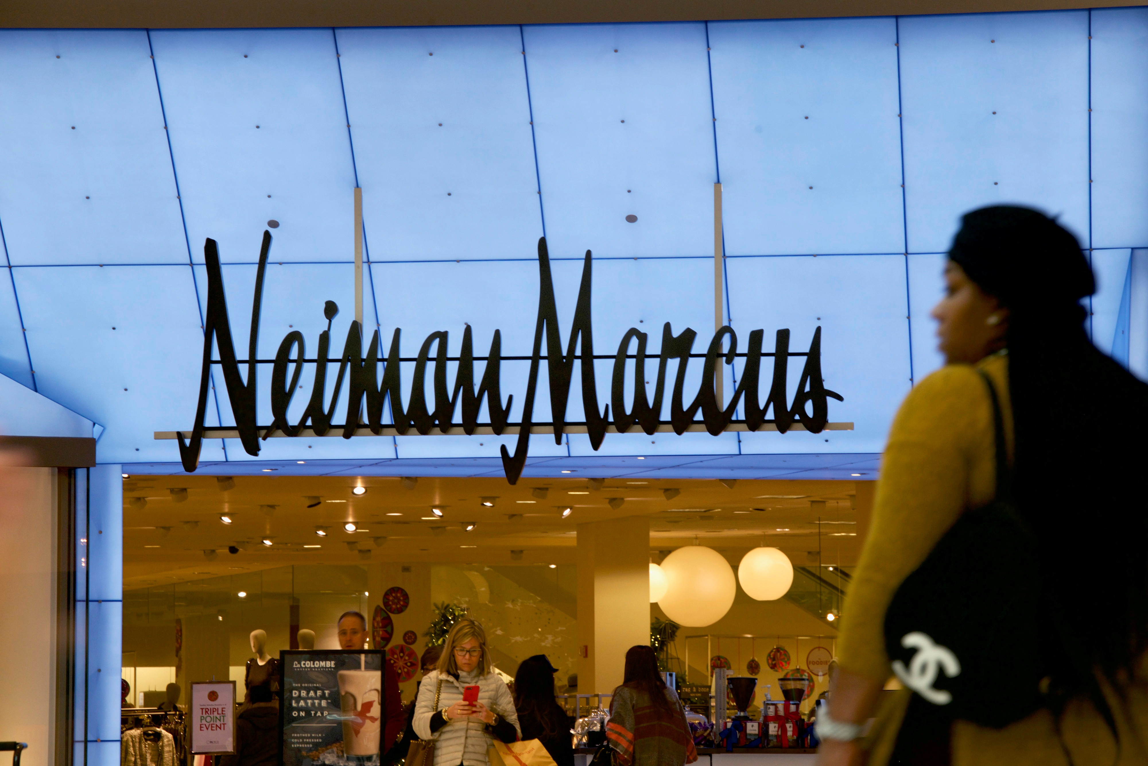 Shoppers enter and exit the Neiman Marcus at the King of Prussia Mall, United States' largest retail shopping space, in King of Prussia, Pennsylvania, U.S., December 8, 2018.  REUTERS/Mark Makela/File Photo