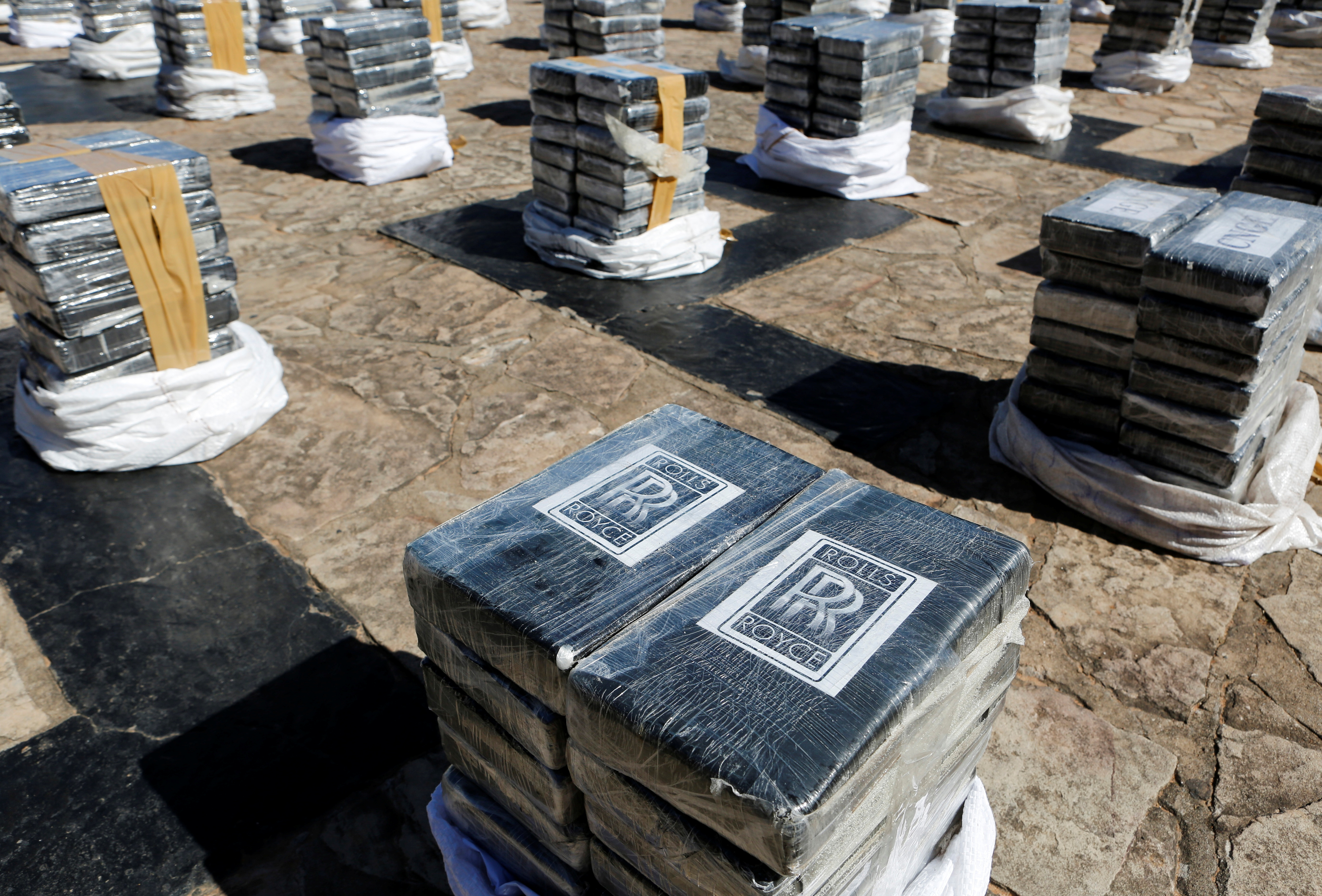 Packages containing cocaine, which were found in a warehouse ready to be shipped abroad along with a load of organic sugar according to authorities, are seen put on display by Paraguayan police in Asuncion, Paraguay July 28, 2021. REUTERS/Cesar Olmedo