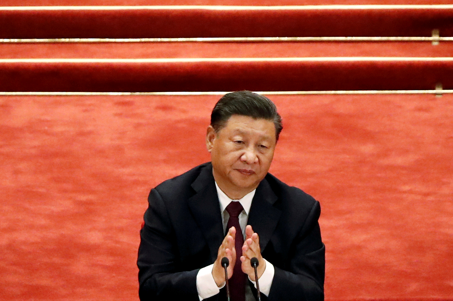 Chinese President Xi Jinping applauds during a meeting to commend role models in China's fight against the coronavirus disease (COVID-19) outbreak, at the Great Hall of the People in Beijing, China September 8, 2020. REUTERS/Carlos Garcia Rawlins/File Photo