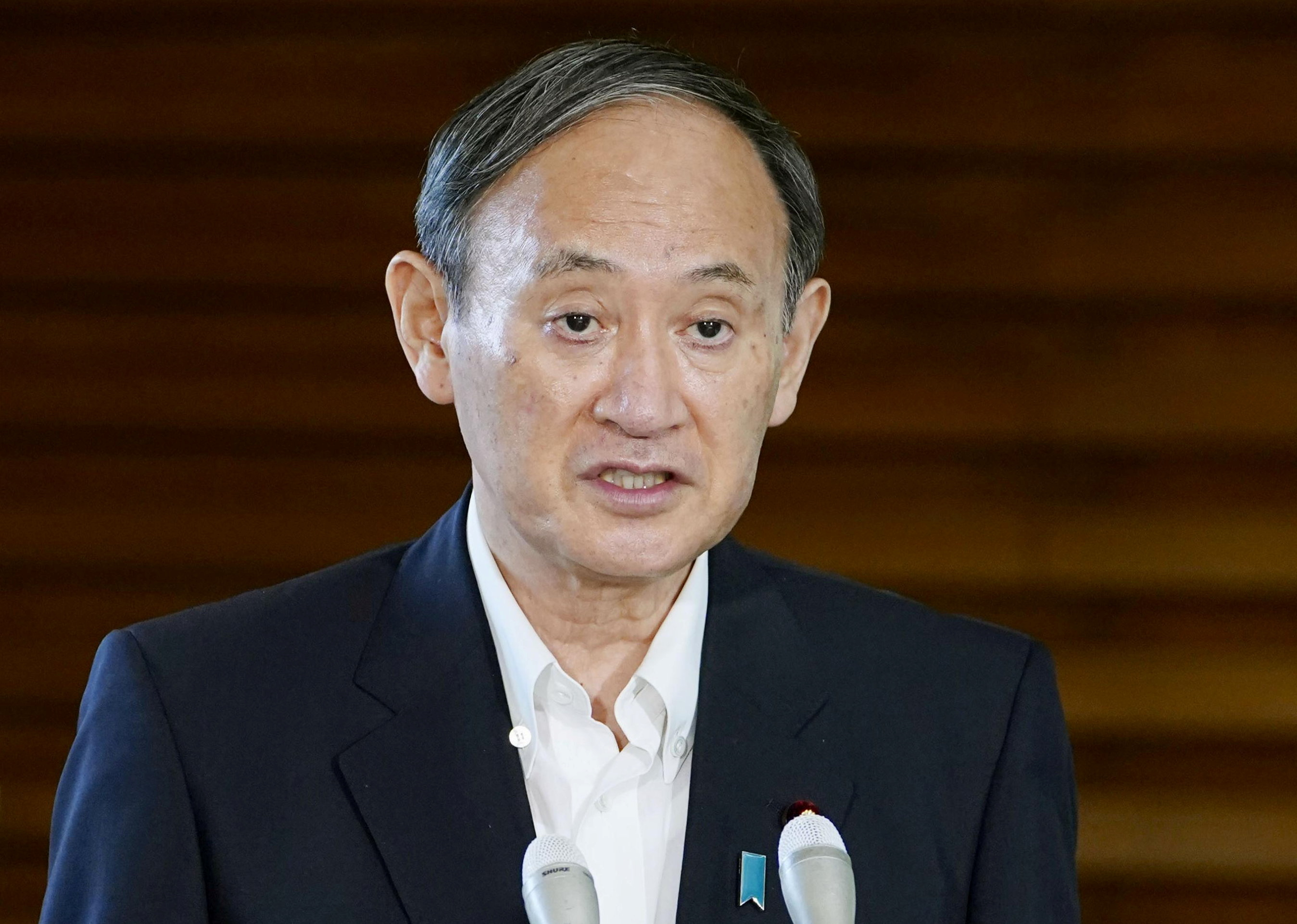 Japan's Prime Minister Yoshihide Suga speaks to media after reports on North Korea fired a pair of ballistic missiles at his official residence in Tokyo, Japan September 15, 2021, in this photo taken by Kyodo. Mandatory credit Kyodo/via REUTERS