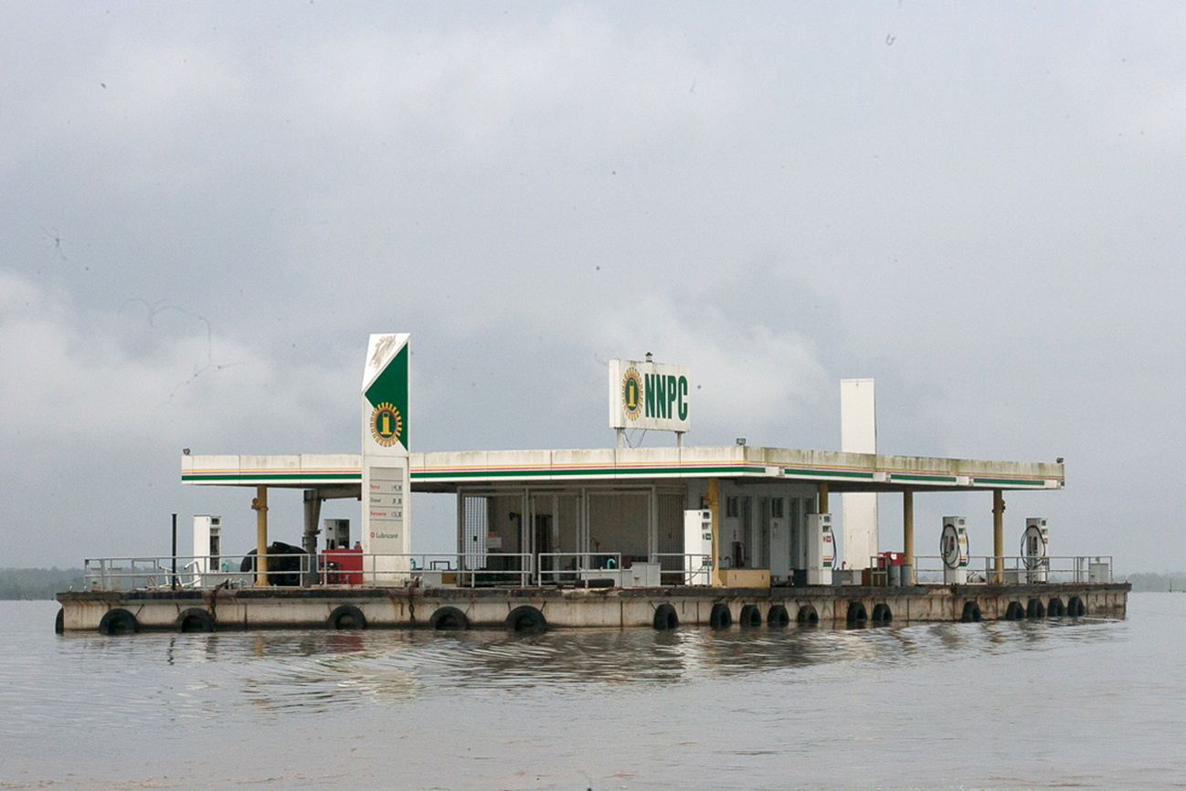 A floating fuel filling station belonging to Nigeria's state oil firm Nigerian National Petroleum Corporation (NNPC) sits idle on a river in the oil rich southeastern Delta state, Nigeria June 18, 2017. REUTERS/Tife Owolabi/File Photo