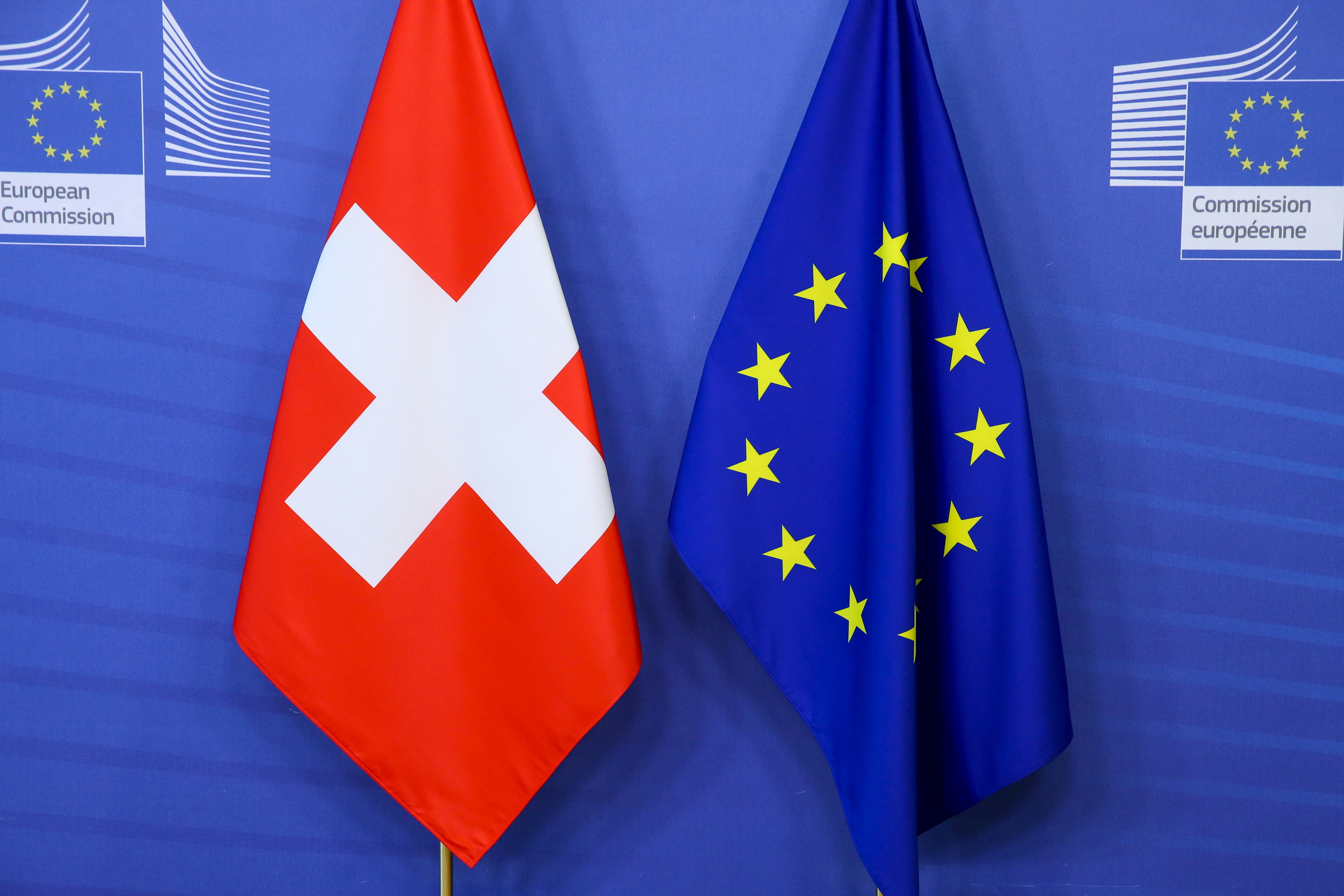 Switzerland's national flag and the European Union flag are seen at the European Commission building in Brussels, Belgium April 23, 2021. Francois Walschaerts/Pool via REUTERS/File Photo