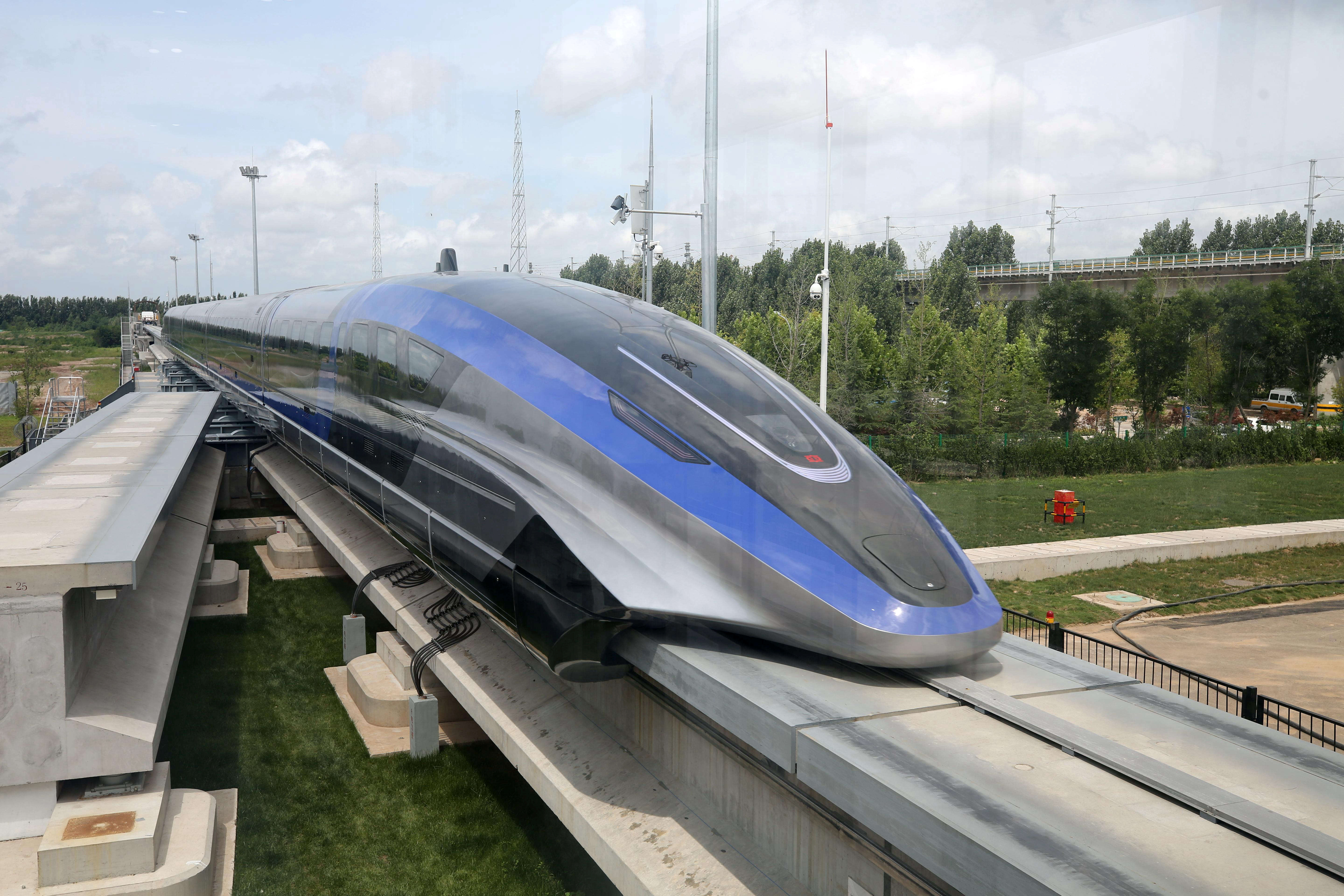 A high-speed maglev train, capable of a top speed of 600 kph, is pictured in Qingdao, Shandong province, China July 20, 2021. cnsphoto via REUTERS