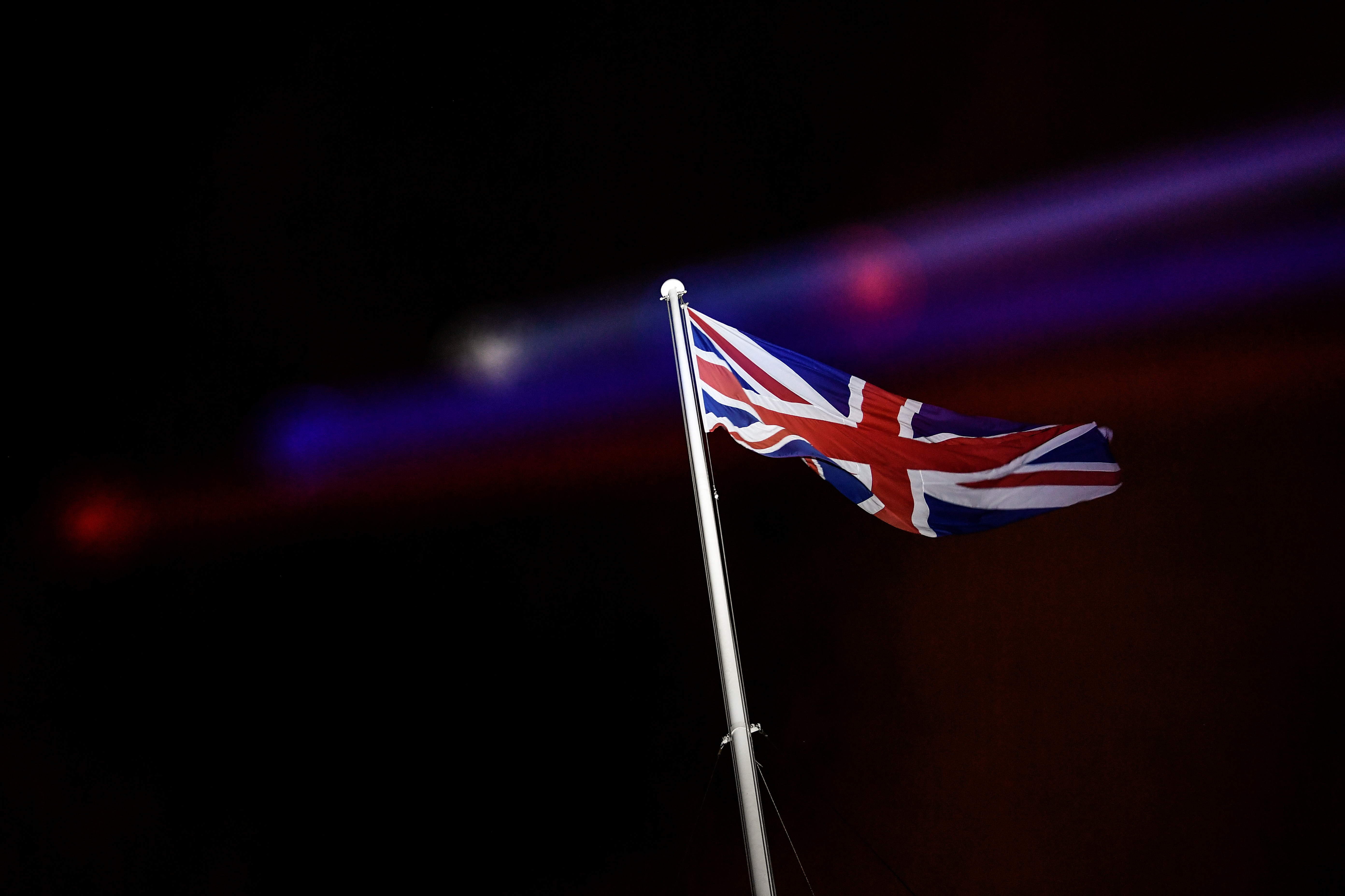 An illuminated British flag is seen at 10 Downing Street on Brexit day in London, Britain January 31, 2020. REUTERS/Toby Melville