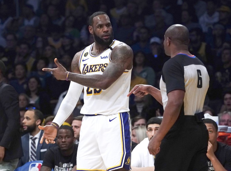 Feb 23, 2020; Los Angeles, California, USA; Los Angeles Lakers forward LeBron James (23) reacts to a call by referee Tony Brown (6) in the first half against the Boston Celtics at Staples Center. / Kirby Lee-USA TODAY Sports/File Photo