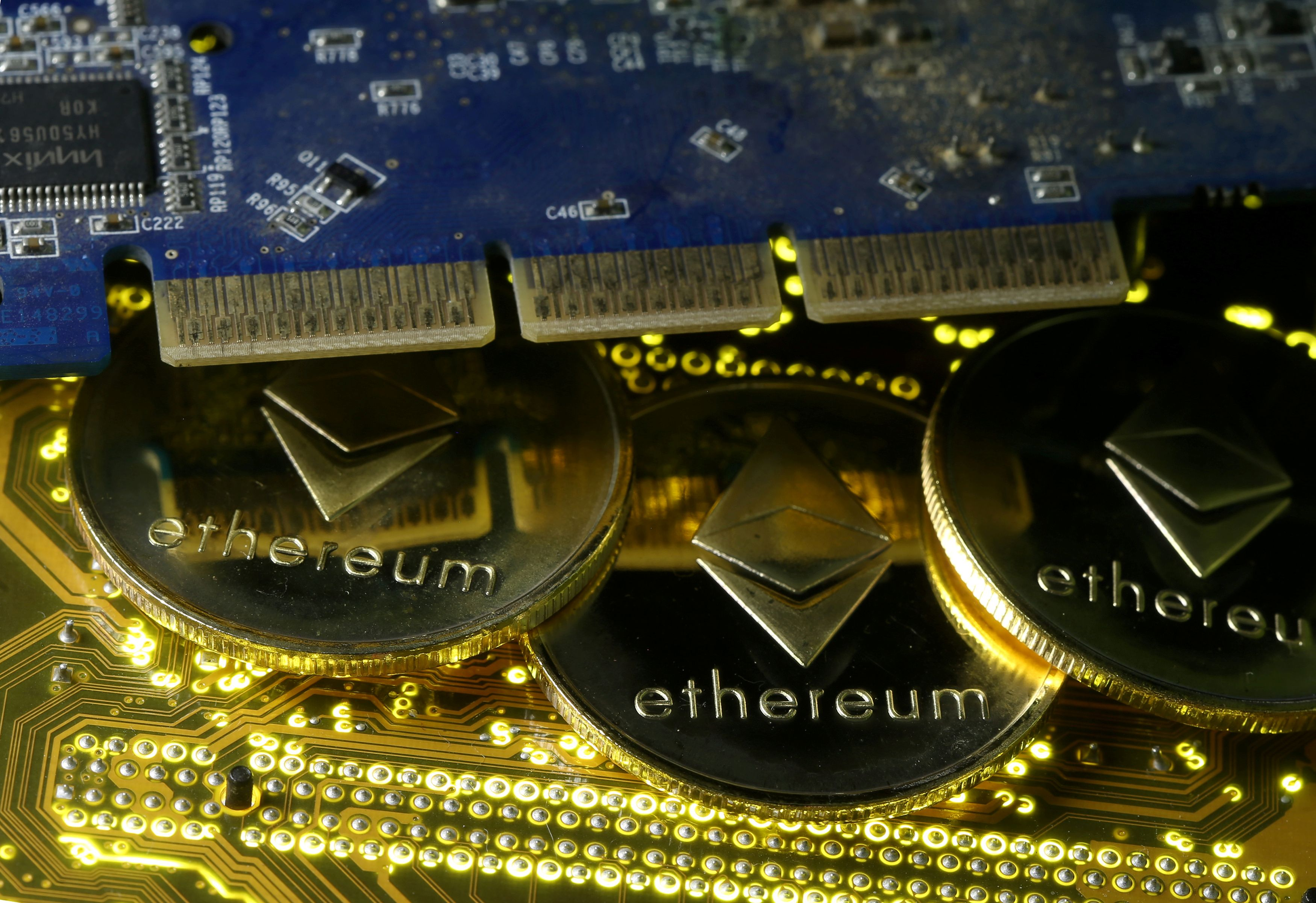 Representations of the Ethereum virtual currency standing on the PC motherboard are seen in this illustration picture, February 3, 2018. REUTERS/Dado Ruvic/Illustration/File Photo