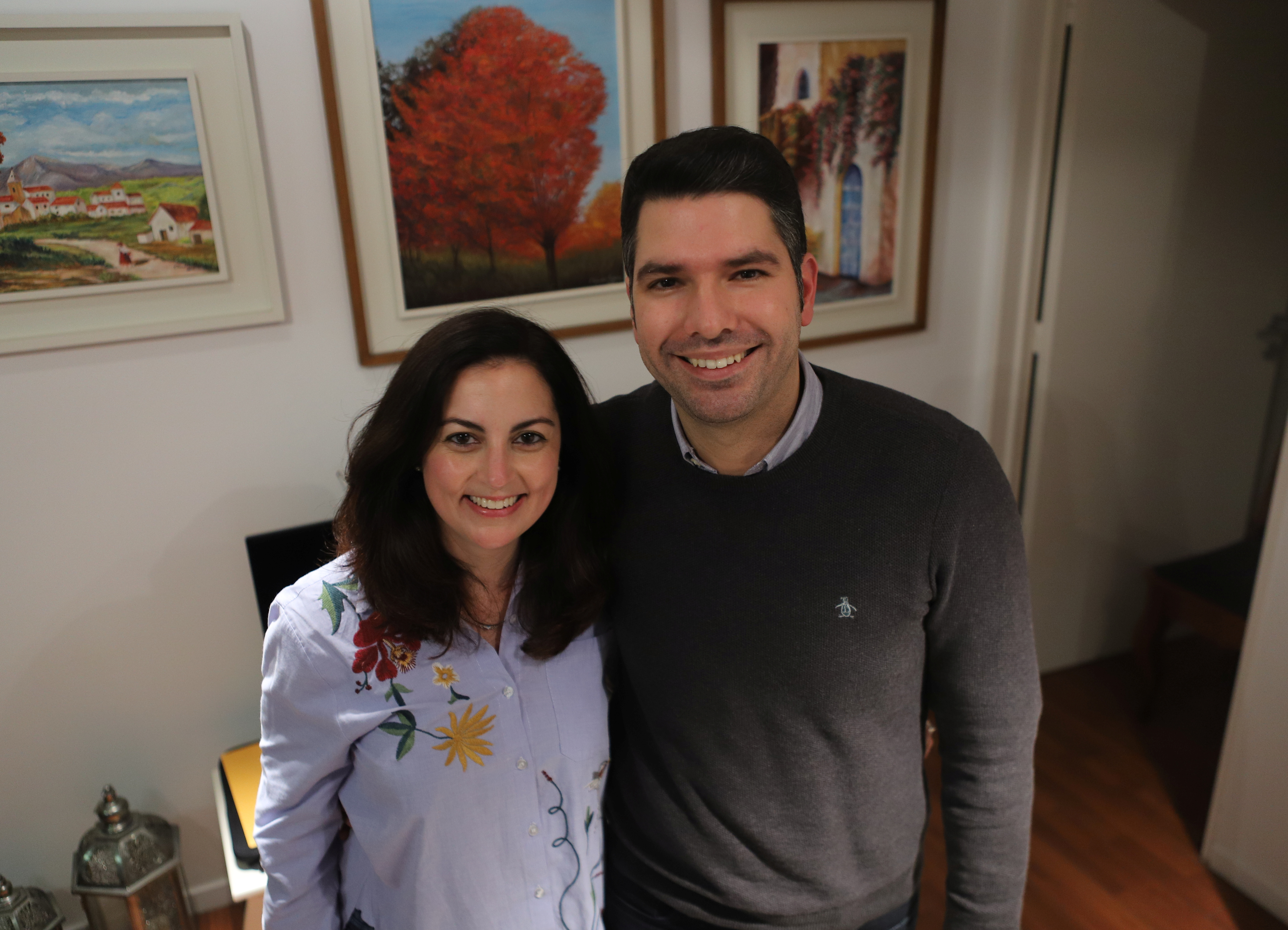 Claudia Becerra, 38, and Agustin Cacciola, 32, pose for a picture at their home, in Buenos Aires, Argentina July 15, 2021. Picture taken July 15, 2021. REUTERS/Matias Baglietto