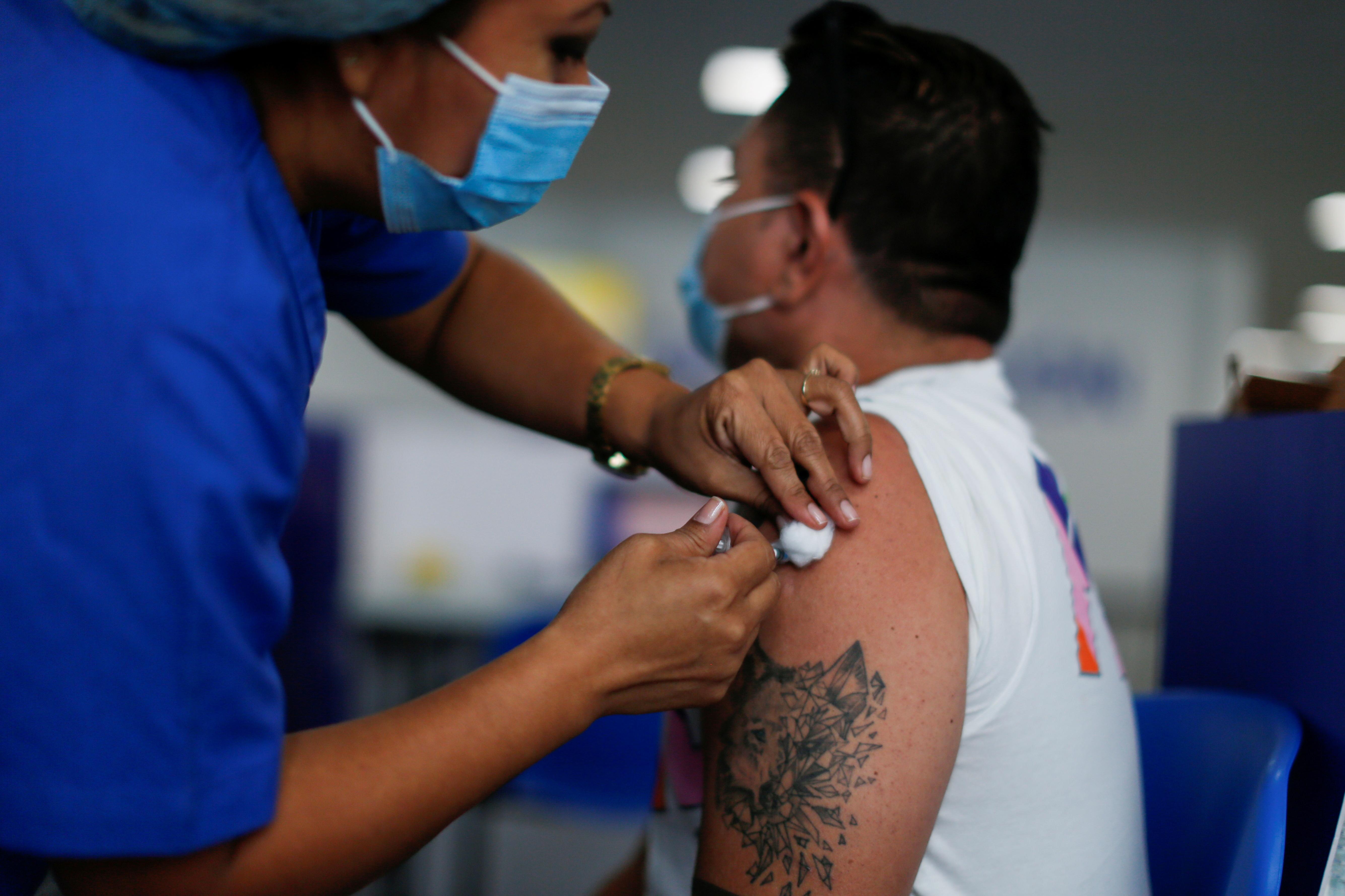 A healthcare worker applies a dose of the AstraZeneca coronavirus disease (COVID-19) vaccine in a vaccination center in San Salvador, El Salvador, June 22, 2021. REUTERS/Jose Cabezas
