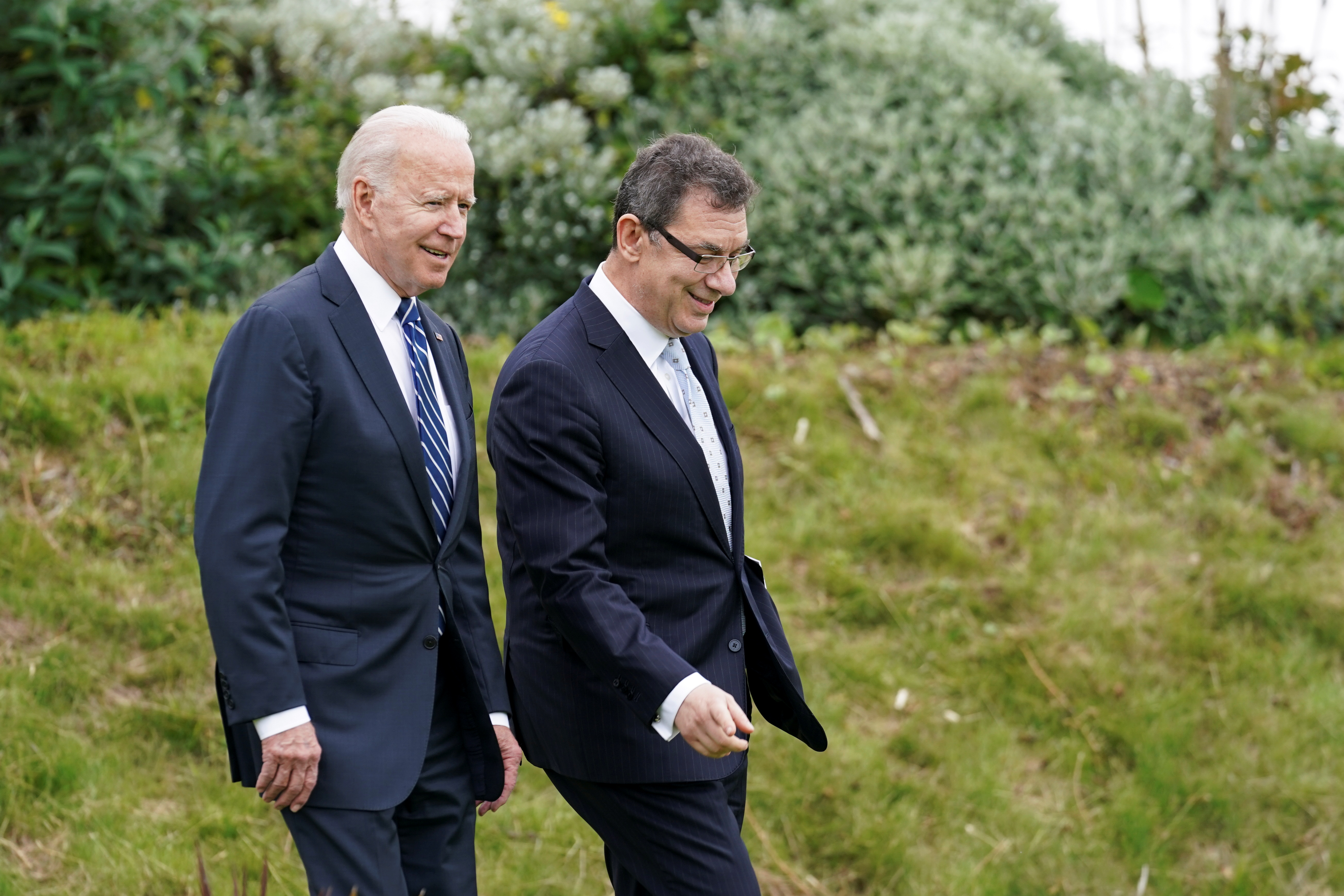 U.S. President Joe Biden arrives with Pfizer CEO, Albert Bourla, to make remarks about the coronavirus disease (COVID-19) vaccine during a visit to St. Ives in Cornwall, Britain, June 10, 2021. REUTERS/ Kevin Lamarque