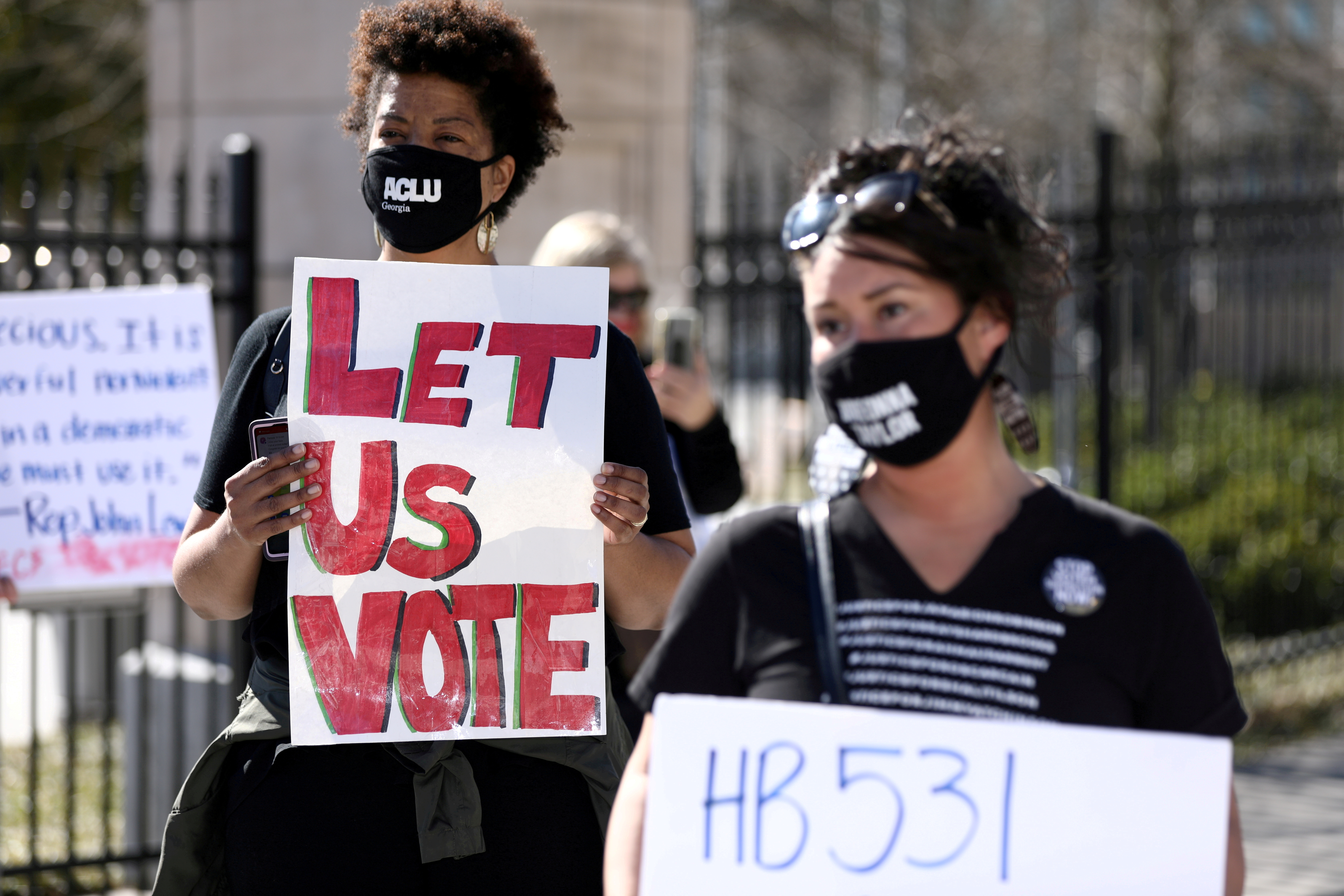 Protesters gather outside of the Georgia State Capitol to protest HB 531, which would place tougher restrictions on voting in Georgia, in Atlanta, Georgia, U.S. March 4, 2021. REUTERS/Dustin Chambers/File Photo/File Photo/File Photo