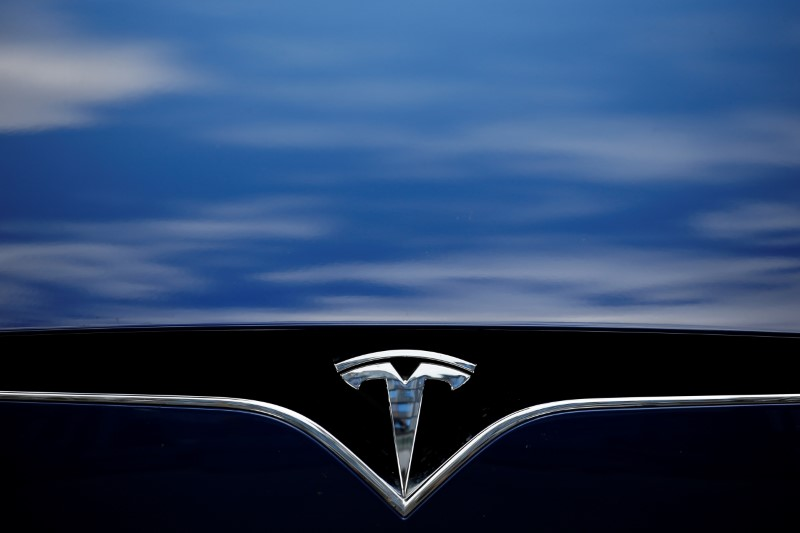 The logo of Tesla cars logo is seen during the presentation of the new charge system in the EUREF campus in Berlin, Germany September 10, 2020. REUTERS/Michele Tantussi