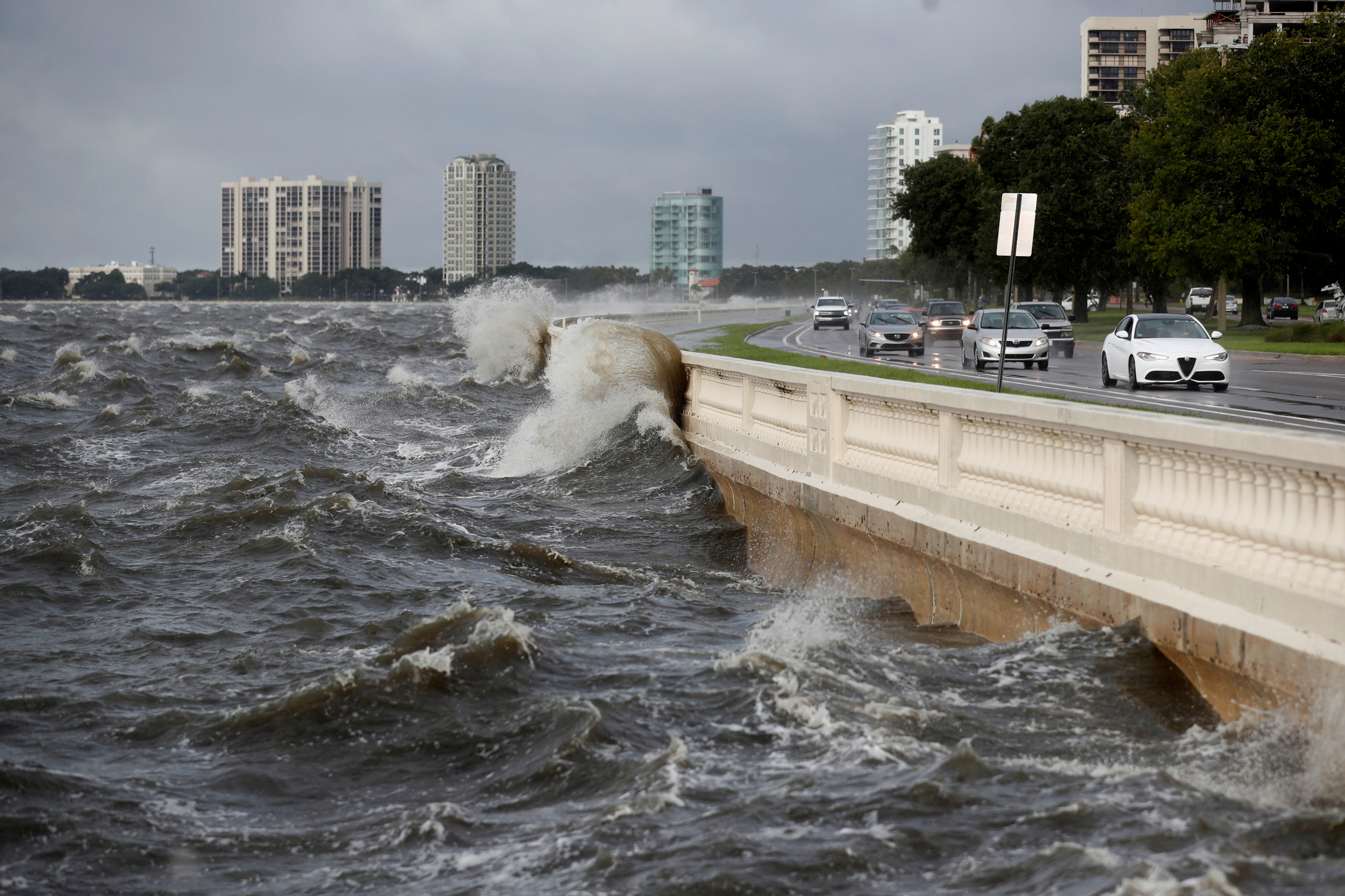 Waves crash the balustrades on Bayshore Boulevard during high tide after Tropical Storm Elsa churns up the Gulf coast, in Tampa, Florida, U.S., July 7, 2021. REUTERS/Octavio Jones/File Photo