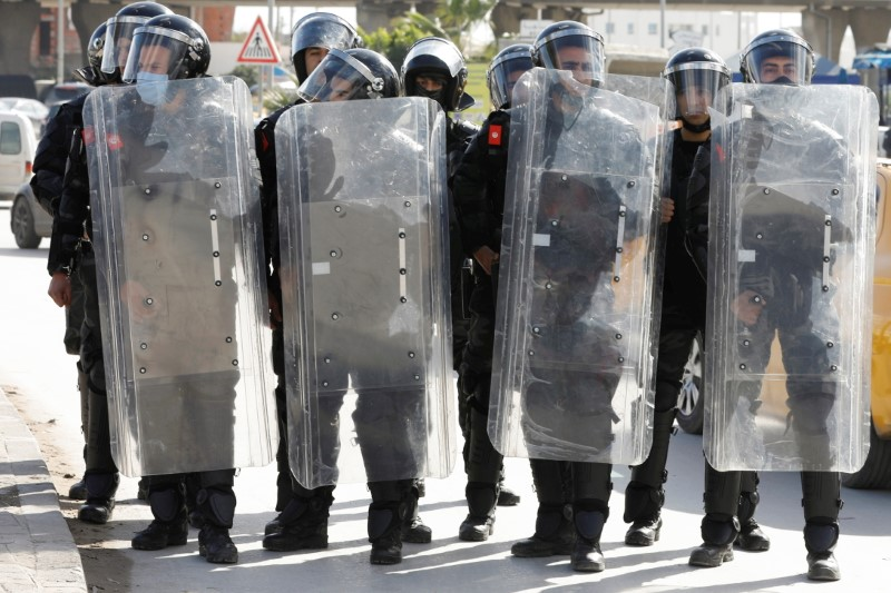 Members of the police stand guard during an anti-government protest in Tunis, Tunisia January 26, 2021. REUTERS/Zoubeir Souissi