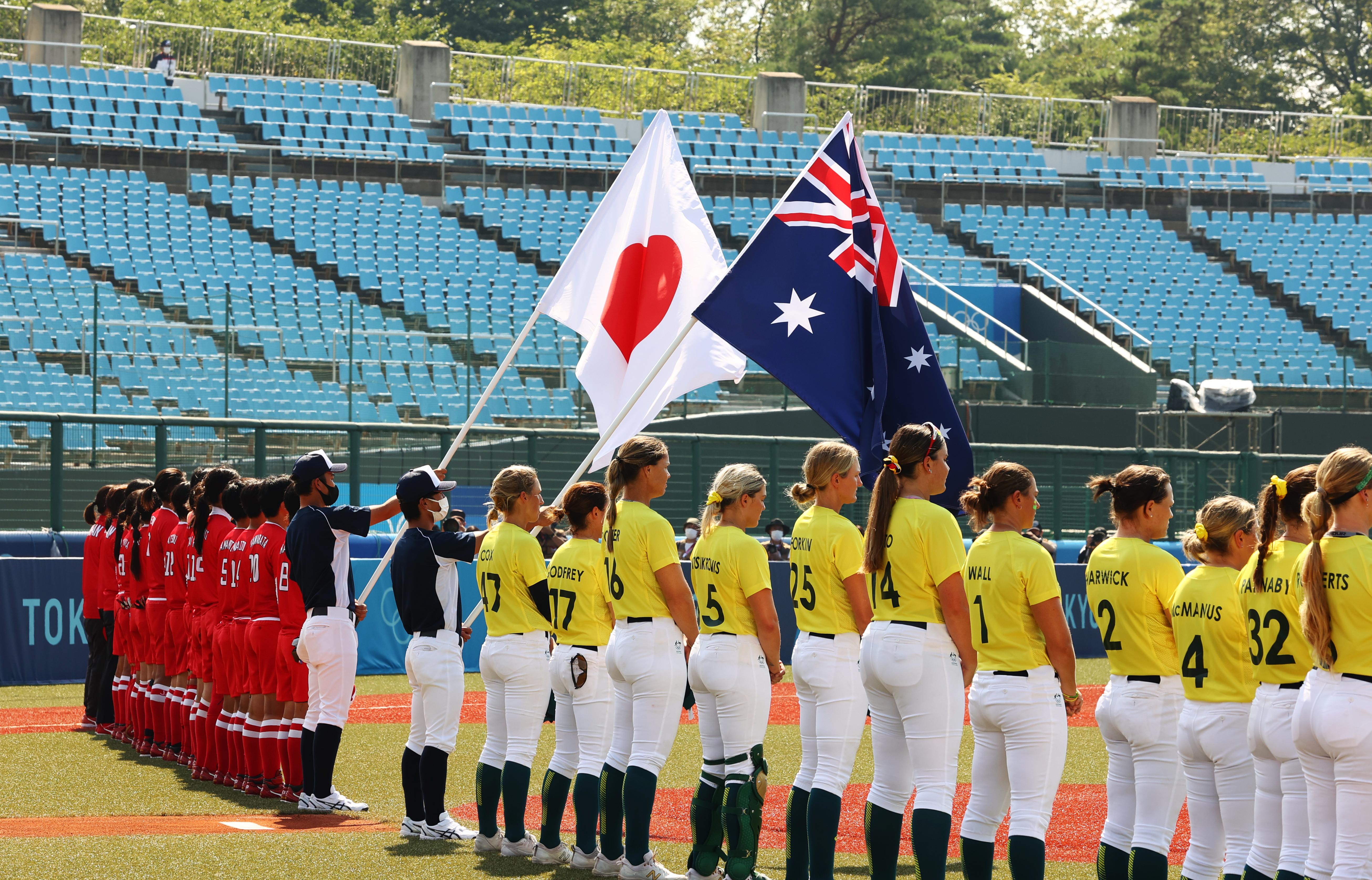 Tokyo 2020 Olympics - Softball - Women - Opening Round - Australia v Japan - Fukushima Azuma Baseball Stadium - Fukushima, Japan - July 21, 2021. Players during national anthems. REUTERS/Jorge Silva