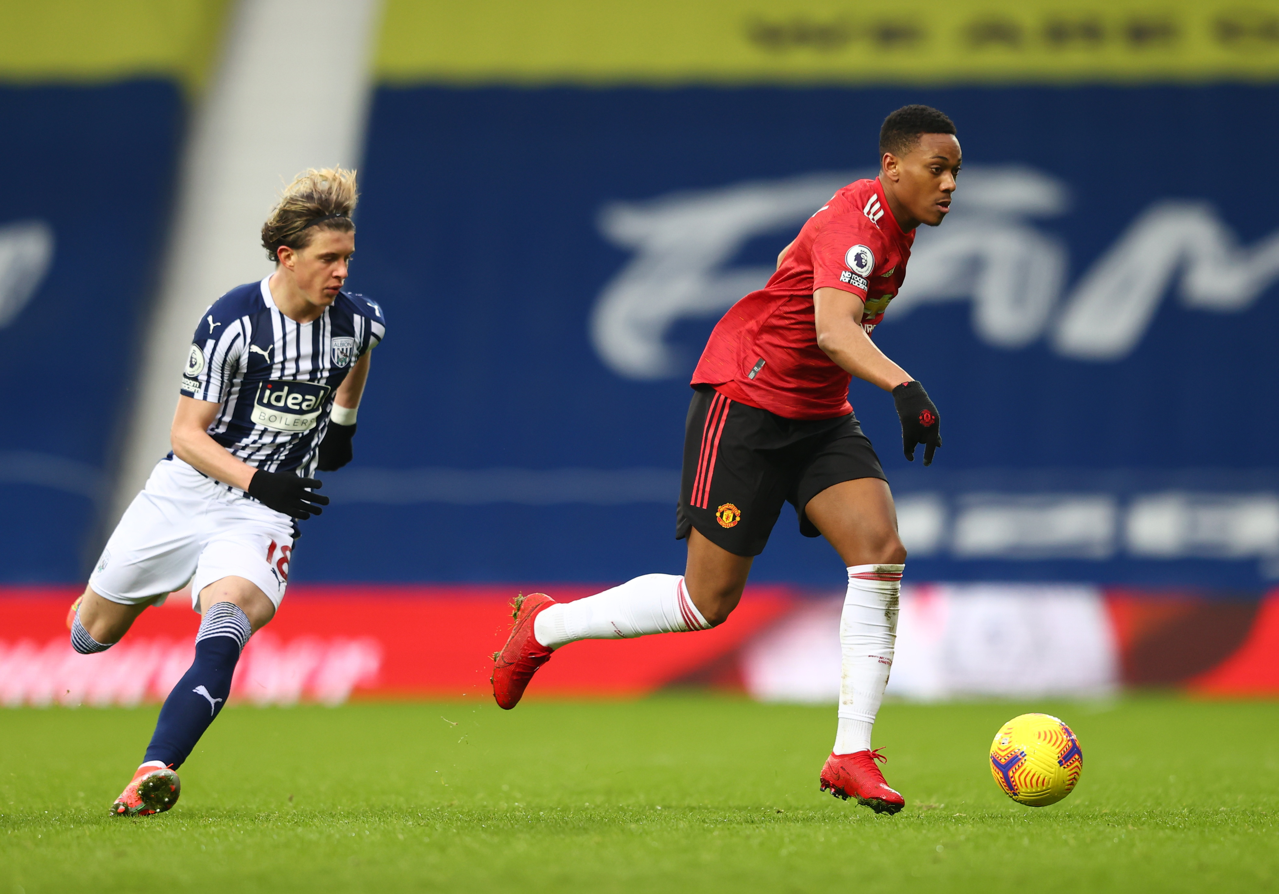 Soccer Football - Premier League - West Bromwich Albion v Manchester United - The Hawthorns, West Bromwich, Britain - February 14, 2021 West Bromwich Albion's Conor Gallagher in action with Manchester United's Anthony Martial Pool via REUTERS/Michael Steele