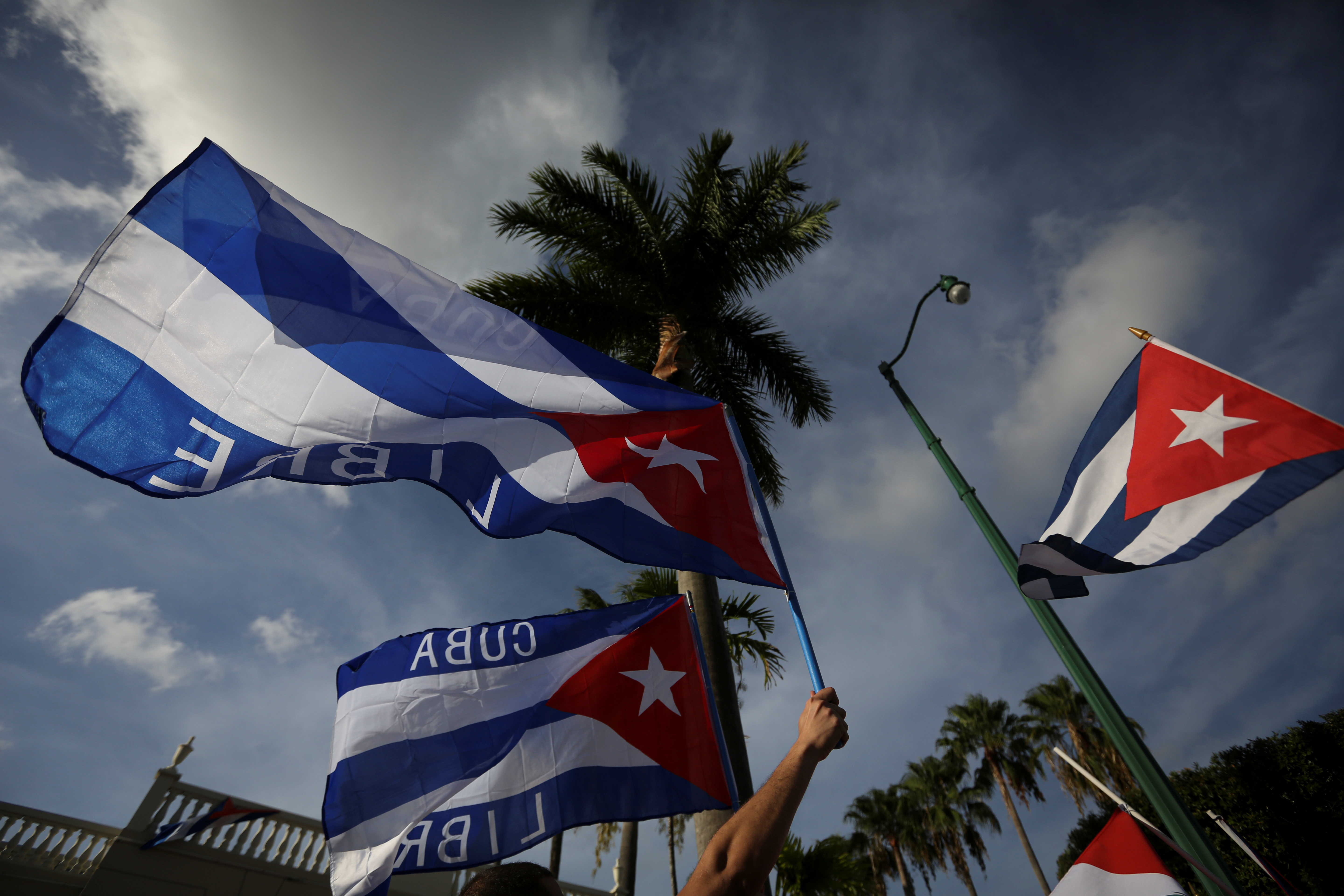 Emigres wave Cuban flags outside Versailles restaurant, in reaction to reports of protests in Cuba against its deteriorating economy, in Miami, Florida, U.S. July 18, 2021. REUTERS/Marco Bello