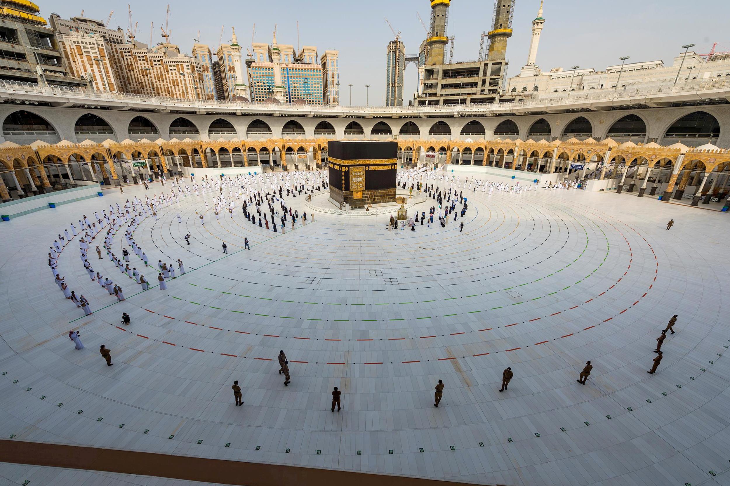 General view of Kaaba as Muslim pilgrims wearing face masks and keeping social distance pray facing Kaaba during the annual Haj pilgrimage amid the coronavirus disease (COVID-19) pandemic, in the holy city of Mecca, Saudi Arabia July 31, 2020. Saudi Press Agency/Handout via REUTERS