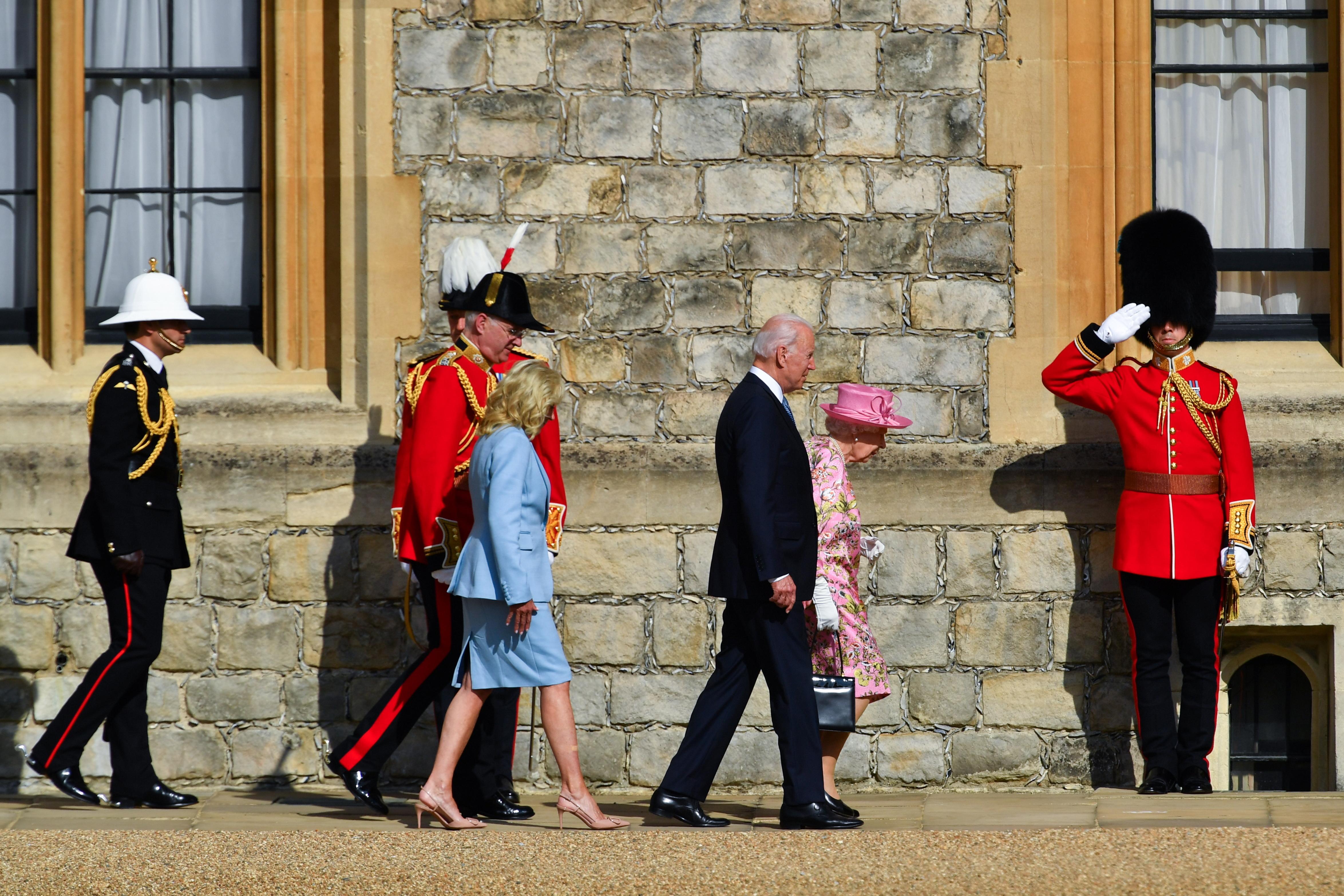 U.S. President Joe Biden and first lady Jill Biden walk next to Britain's Queen Elizabeth, at Windsor Castle in Windsor, Britain, June 13, 2021. REUTERS/Dylan Martinez