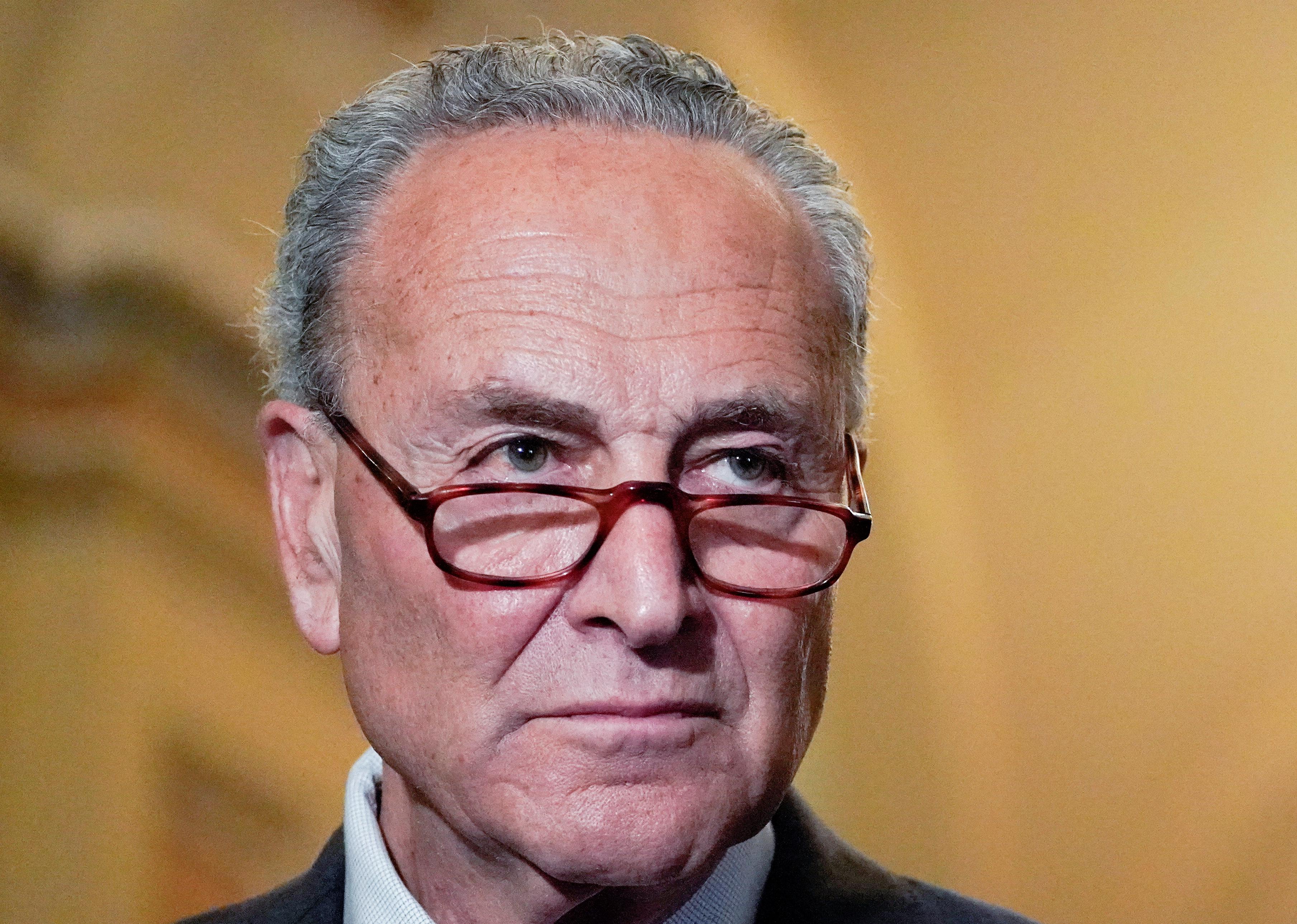 U.S. Senate Majority Leader Chuck Schumer (D-NY) faces reporters following the Senate Democrats weekly policy lunch at the U.S. Capitol in Washington, U.S., July 13, 2021.  REUTERS/Elizabeth Frantz