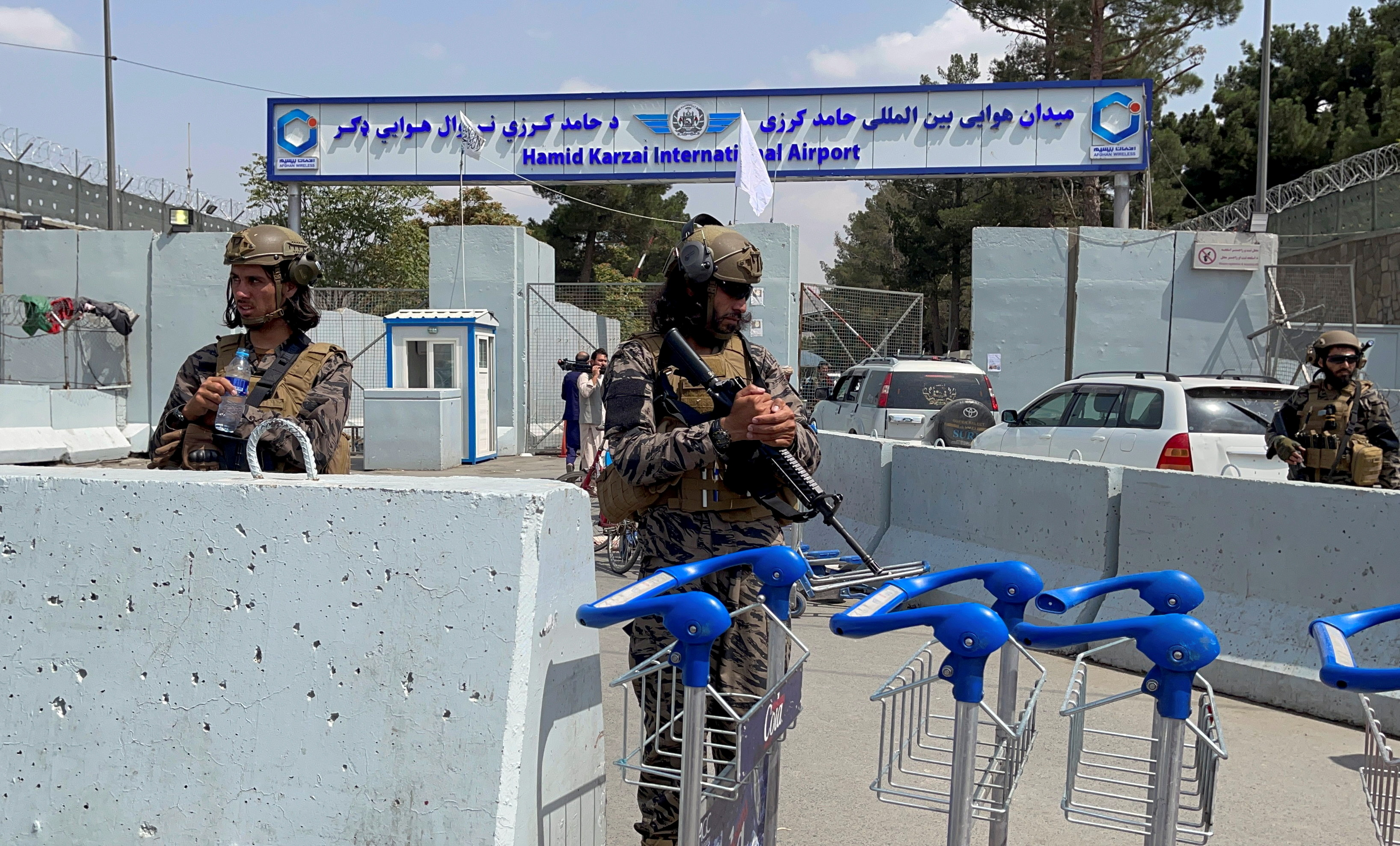 Taliban forces stand guard at the  entrance gate of Hamid Karzai International Airport a day after U.S troops withdrawal in Kabul, Afghanistan August 31, 2021. REUTERS/Stringer/File Photo