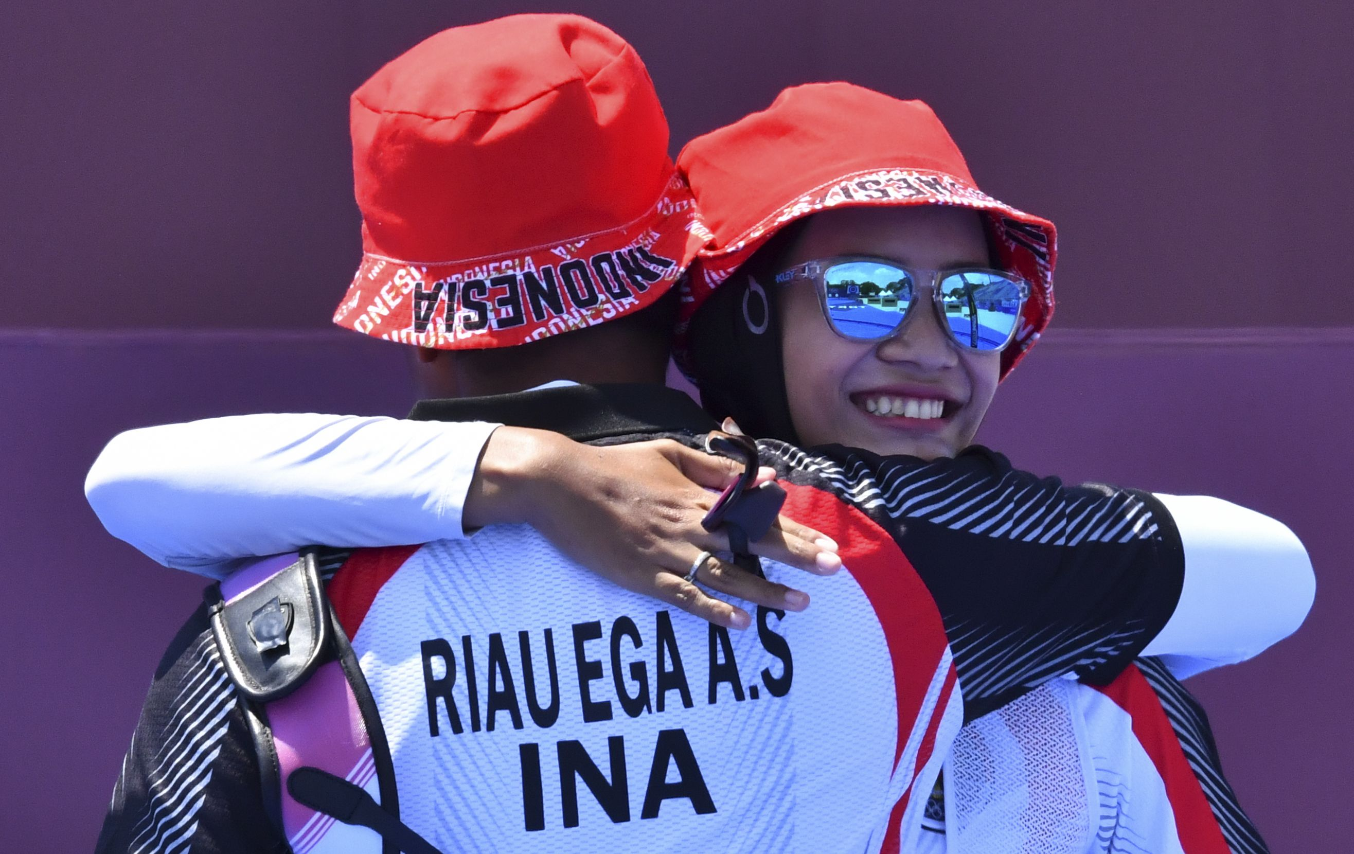 Tokyo 2020 Olympics - Archery - Mixed Team - 1/8 Finals - Yumenoshima Archery Field, Tokyo, Japan - July 24, 2021. Diananda Choirunisa of Indonesia and Agata Riau Ega Salsabilla of Indonesia react REUTERS/Clodagh Kilcoyne