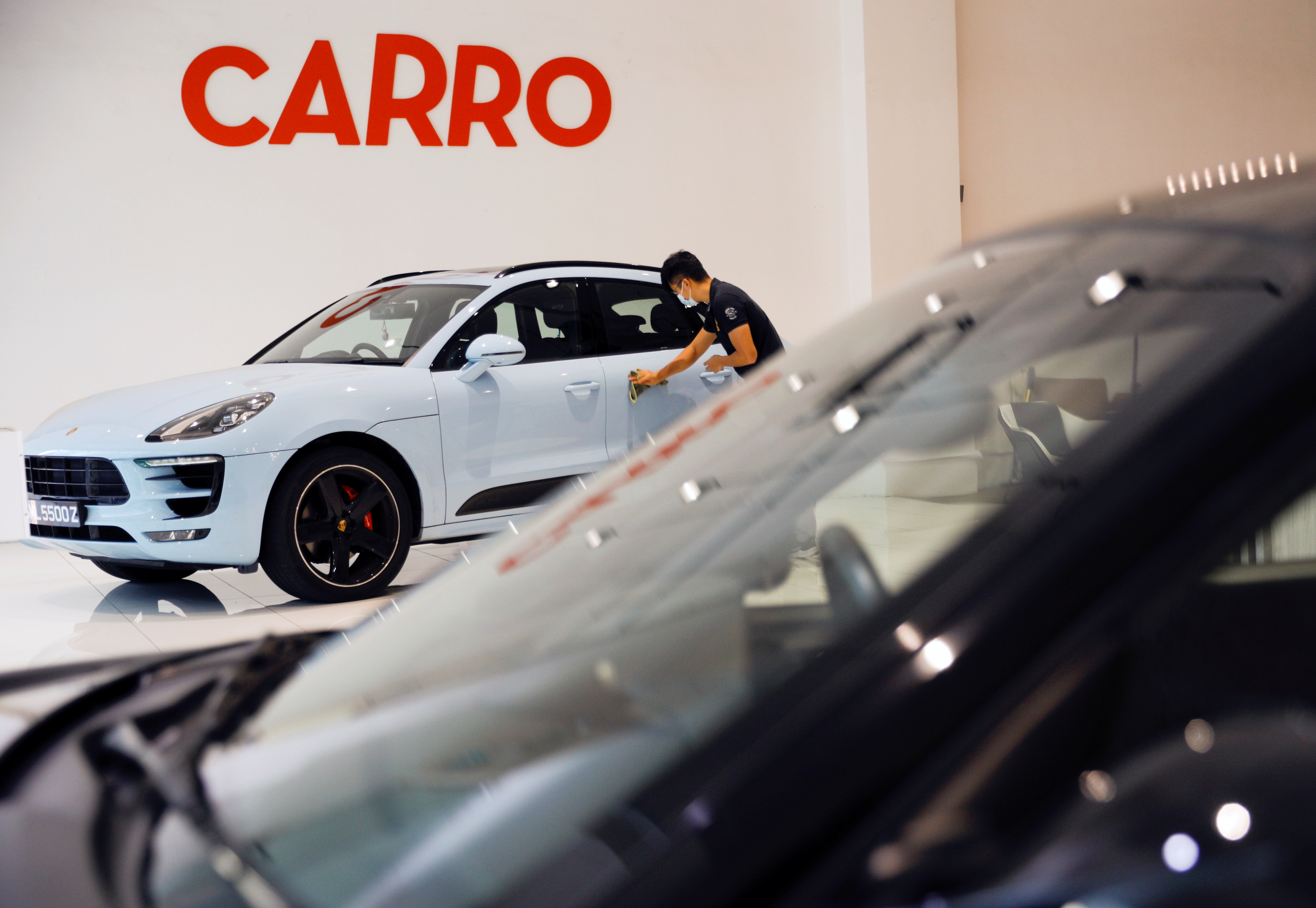 A view of the Carro signage at their showroom in Singapore June 15, 2021.   REUTERS/Edgar Su