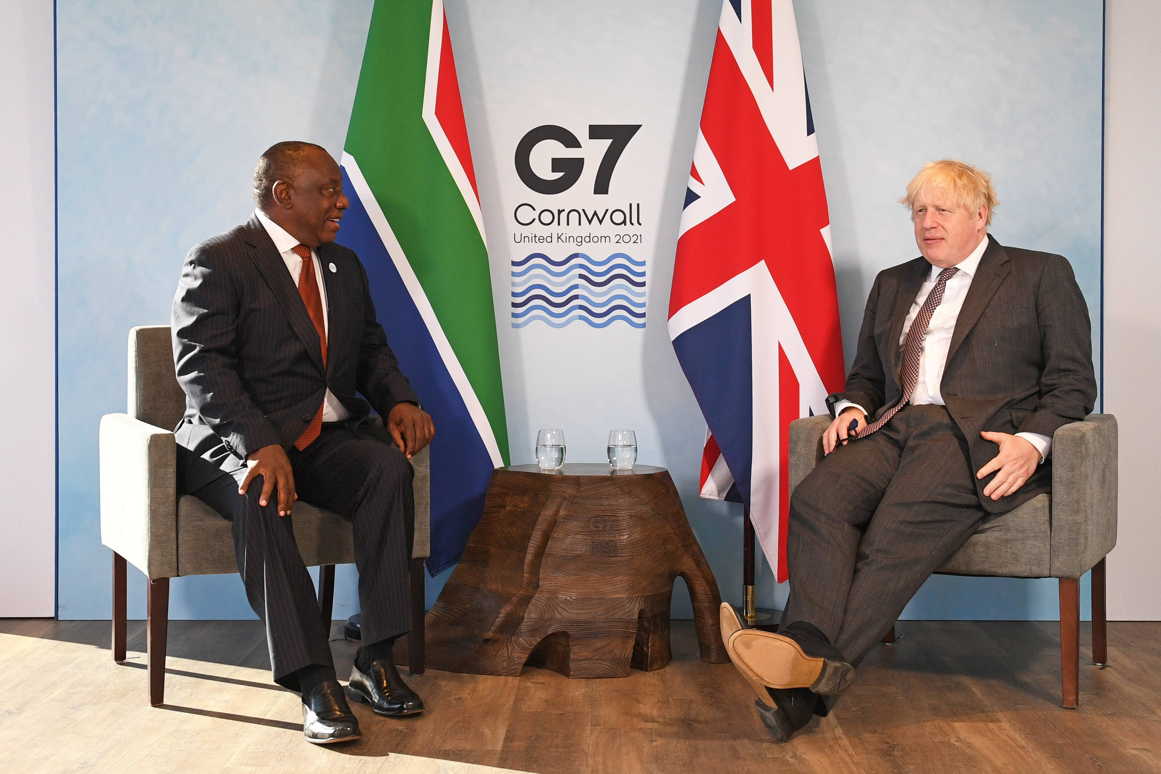 Britain's Prime Minister Boris Johnson and South Africa's President Cyril Ramaphosa attend a bilateral meeting during G7 summit in Carbis Bay, Cornwall, Britain, June 13, 2021. Stefan Rousseau/Pool via REUTERS