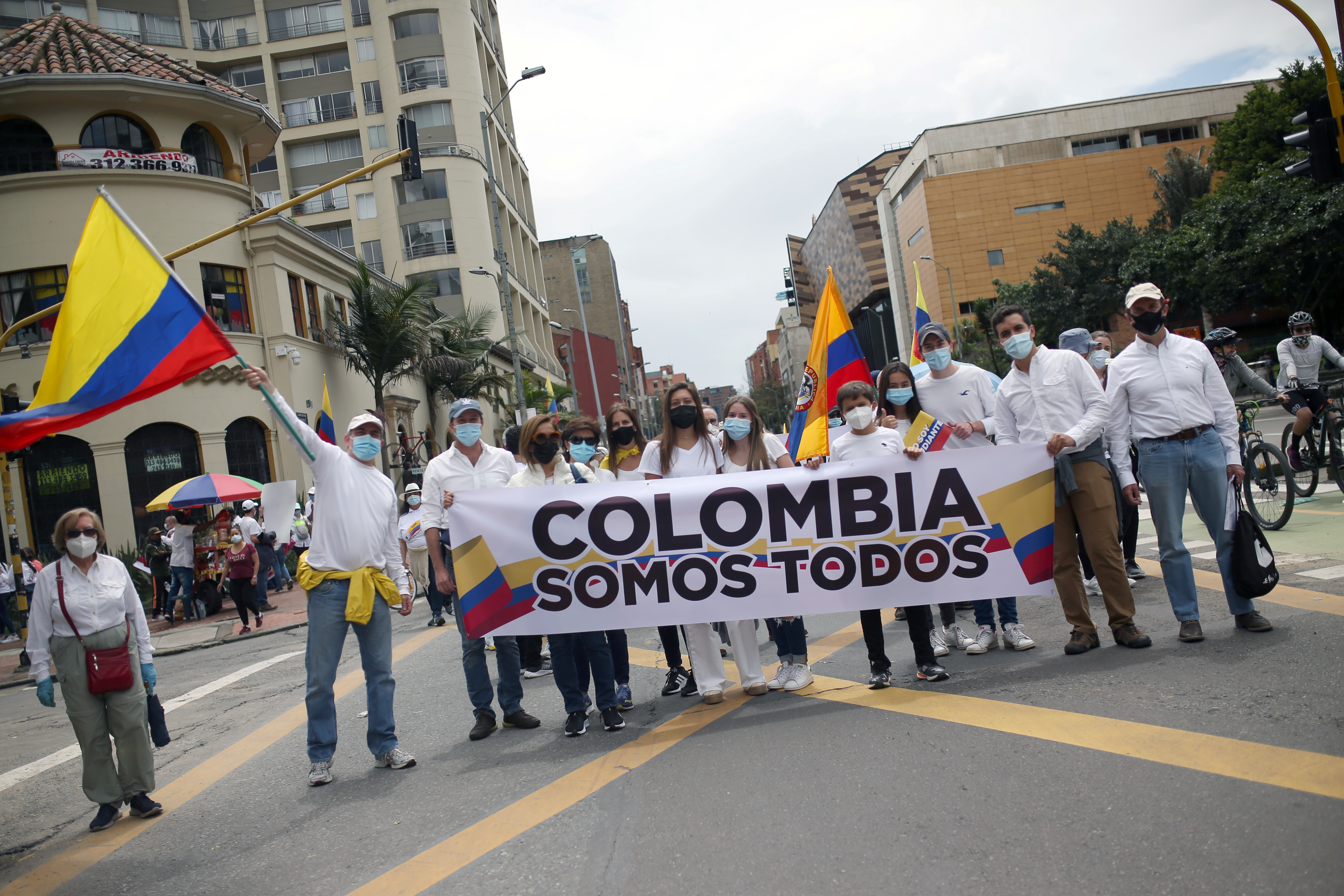 People hold a banner reading