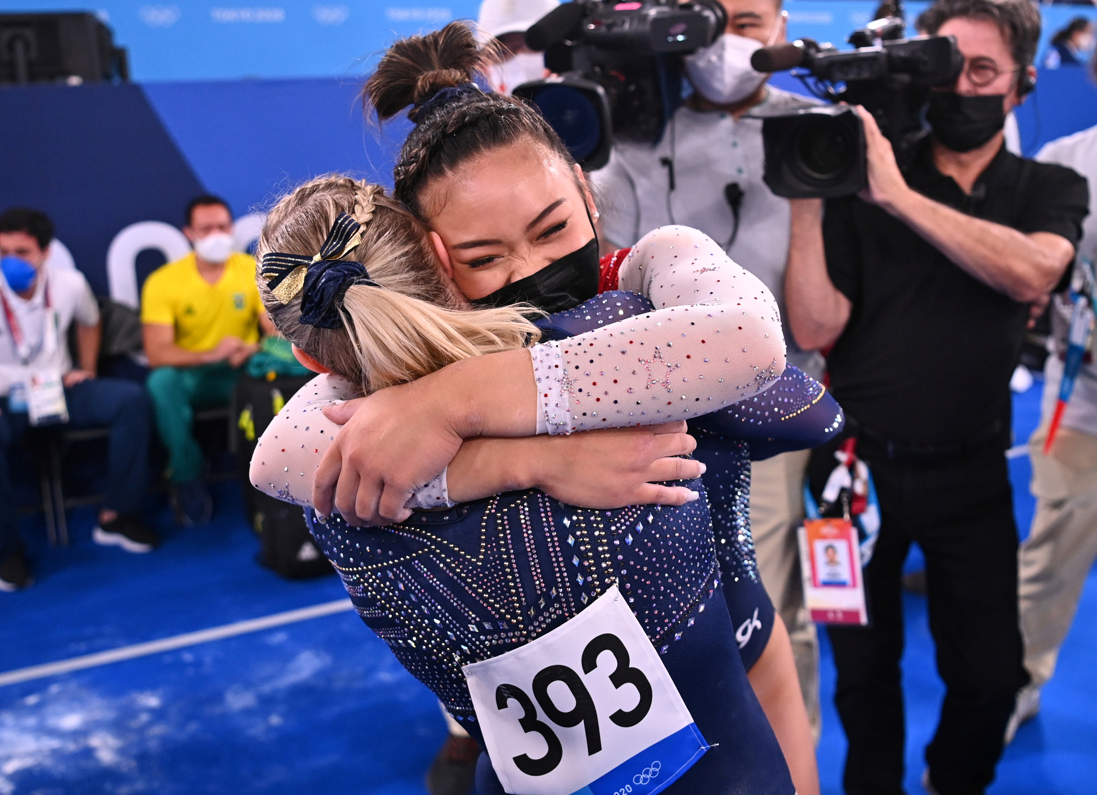 Tokyo 2020 Olympics - Gymnastics - Artistic - Women's Individual All-Around - Final - Ariake Gymnastics Centre, Tokyo, Japan - July 29, 2021. Sunisa Lee of the United States wearing a protective face mask is congratulated by Jade Carey of the United States after winning gold REUTERS/Dylan Martinez