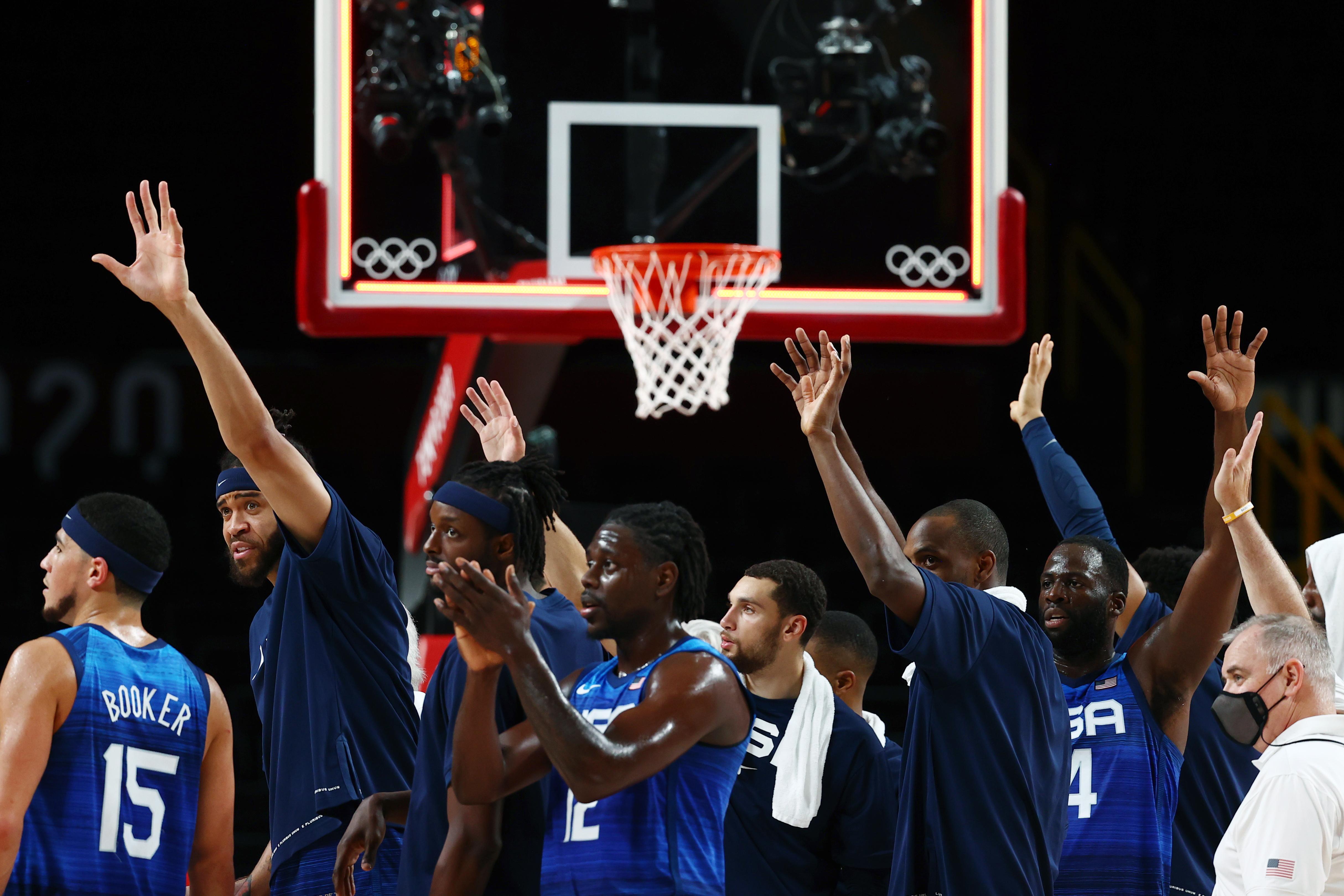 Tokyo 2020 Olympics - Basketball - Men - Quarterfinal - Spain v United States - Saitama Super Arena, Saitama, Japan - August 3, 2021. United States players celebrates after the match REUTERS/Sergio Perez