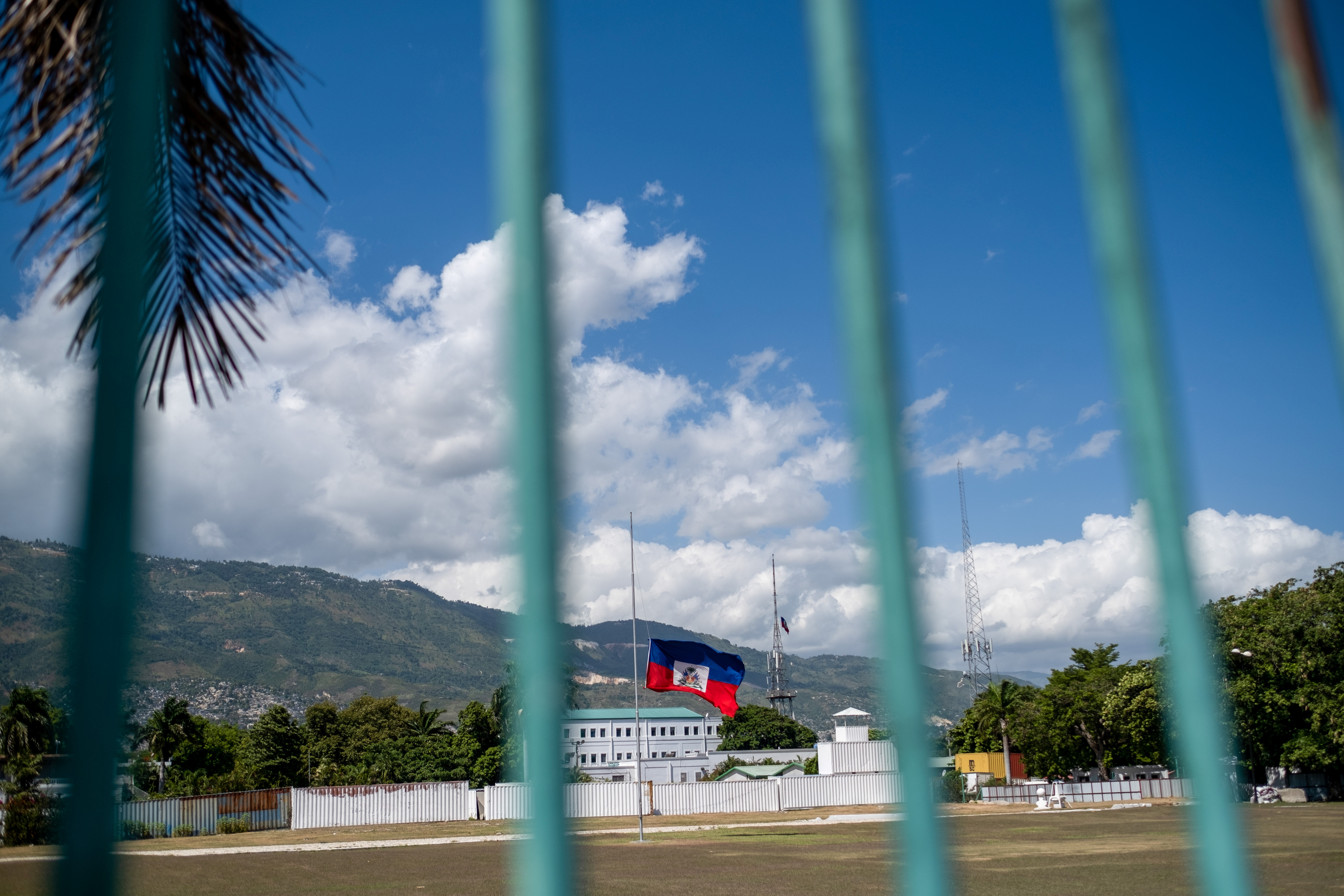 The Haitian national flag waves at half-mast where the Haitian Presidential Palace used to be following the assassination of President Jovenel Moise, in Port-au-Prince, Haiti July 10, 2021. REUTERS/Ricardo Arduengo